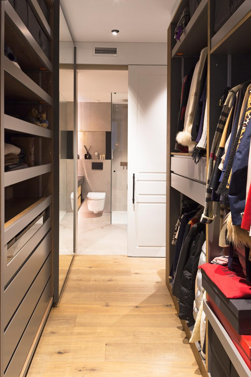 A walk-in closet that leads to the master bathroom.