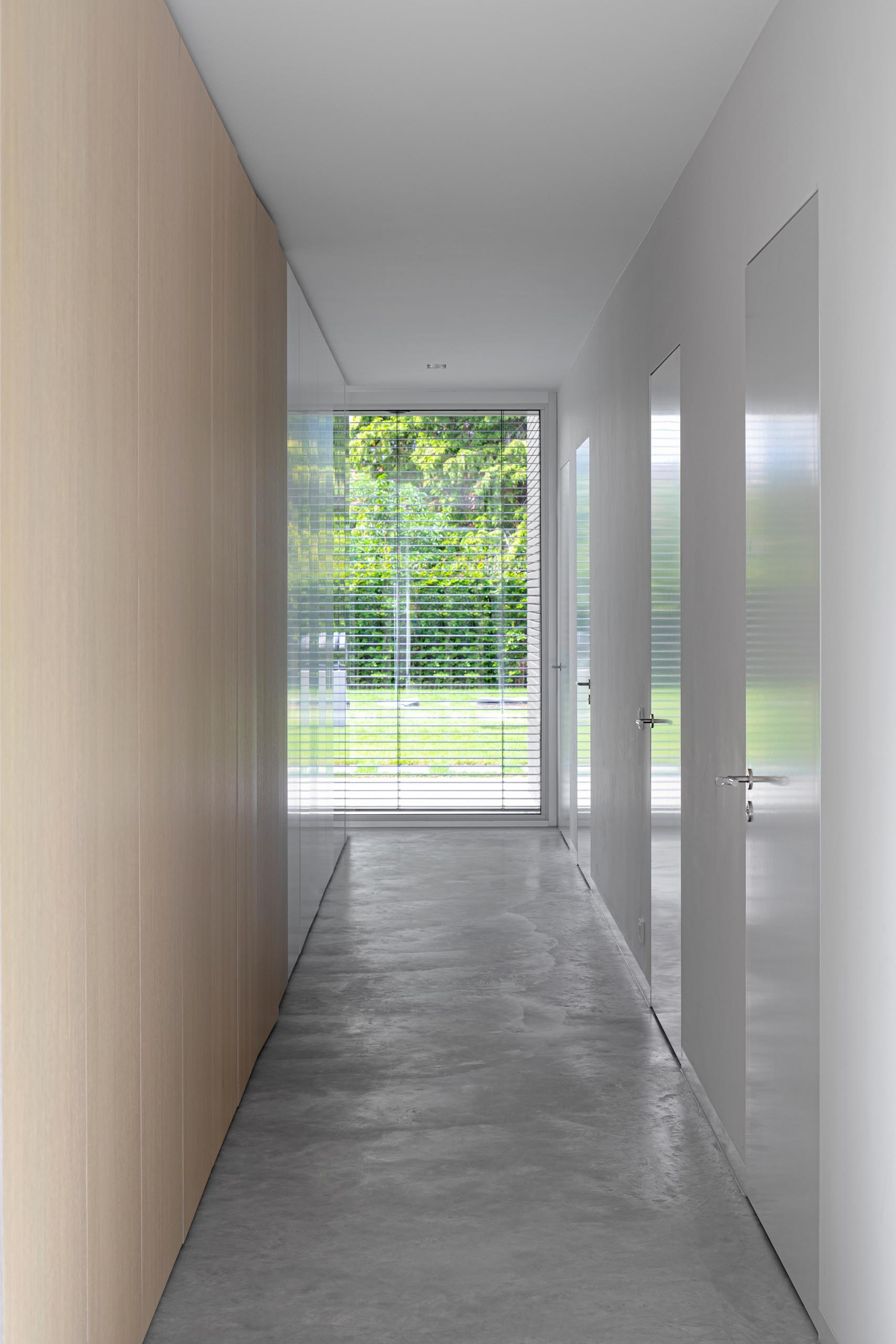 A modern hallway with concrete floors.