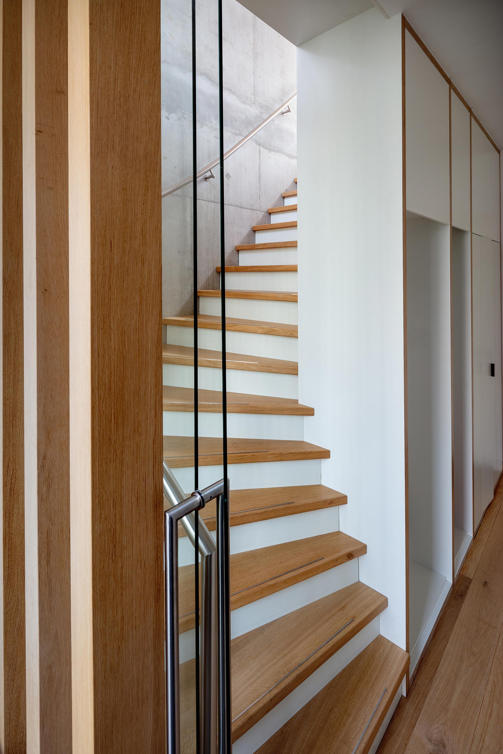 A wood and white staircase.