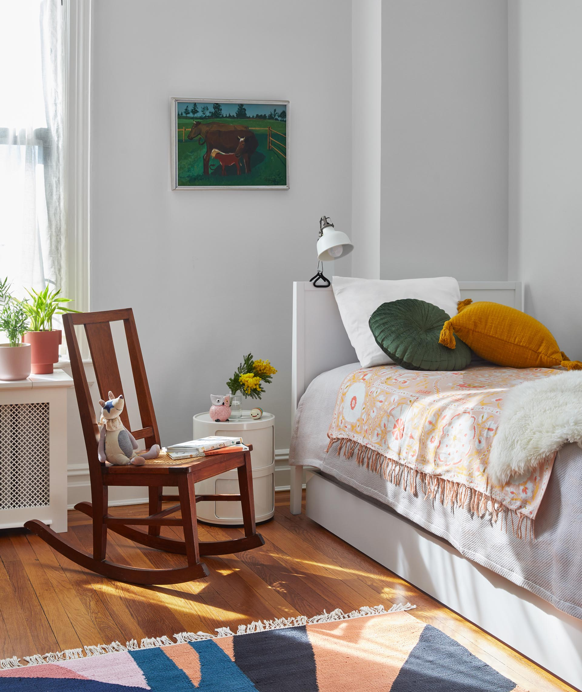 In this kids room, bright and colorful accents stand out against the light-colored walls.
