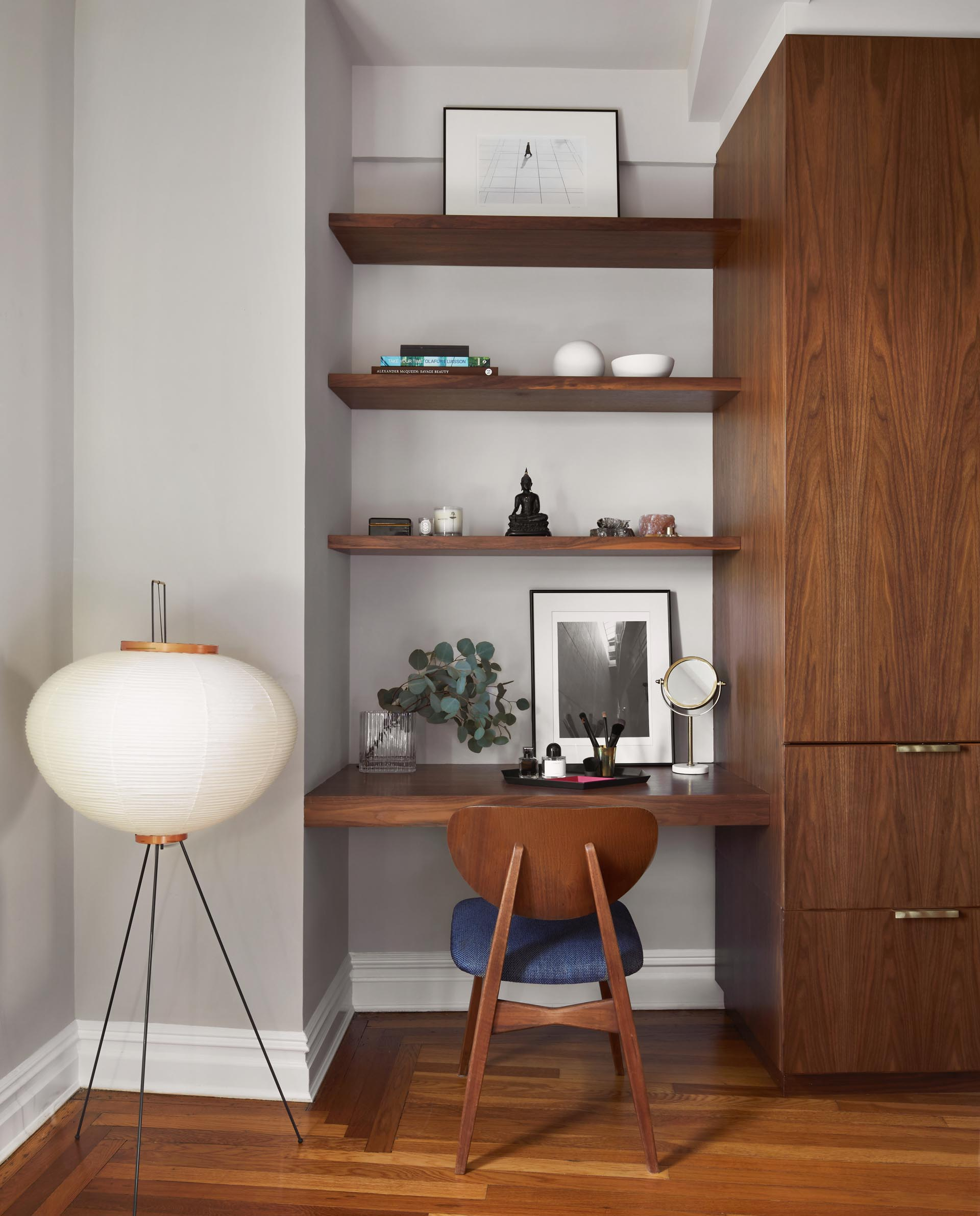 A custom-designed vanity / desk that matches the wood cabinets and shelving.