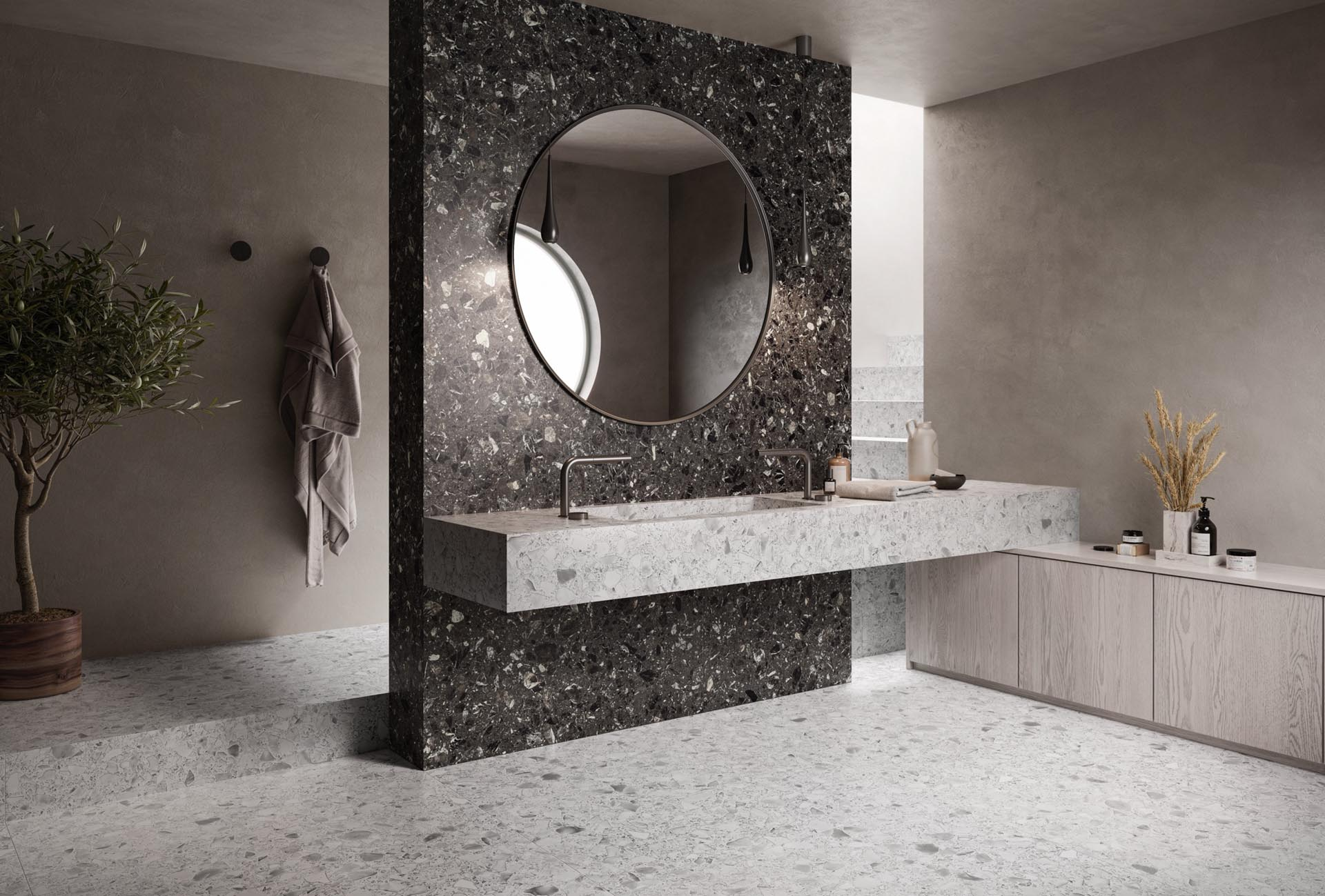 Wall and floor tiles with a confetti-like appearance.