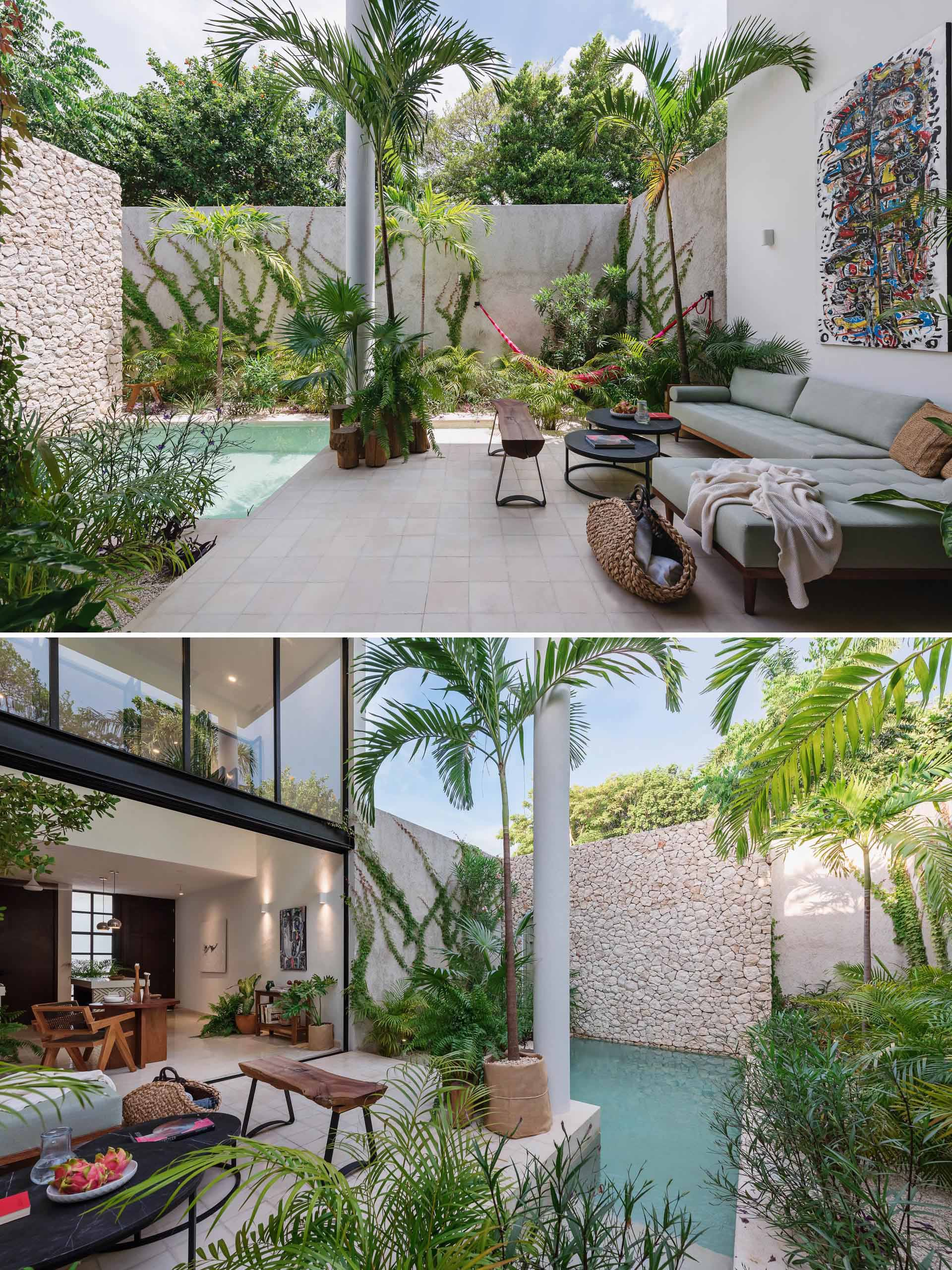 A small house with an outdoor living room, tropical plants, and small pool.