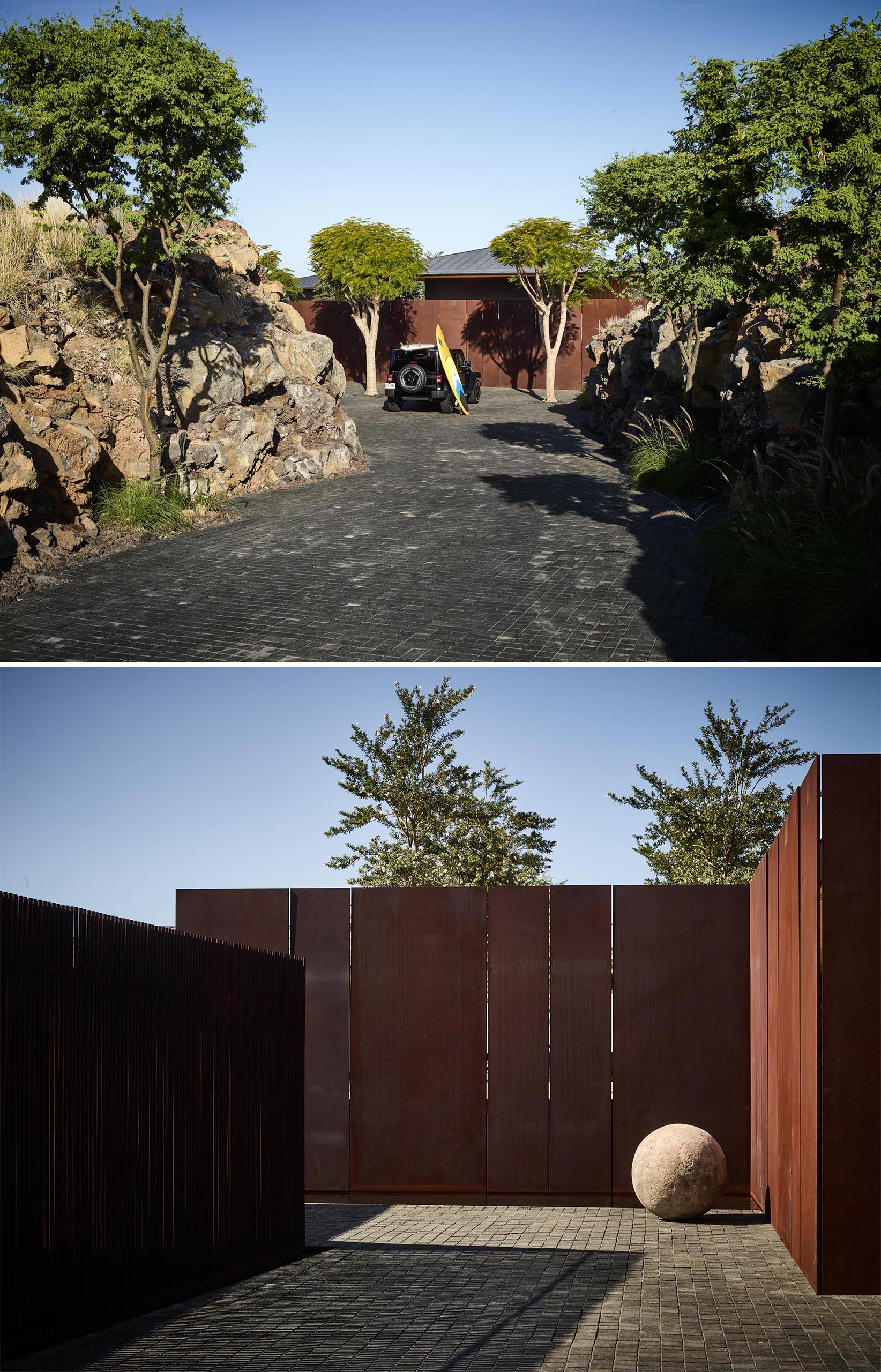 A driveway that leads to a auto court with weathered steel walls.