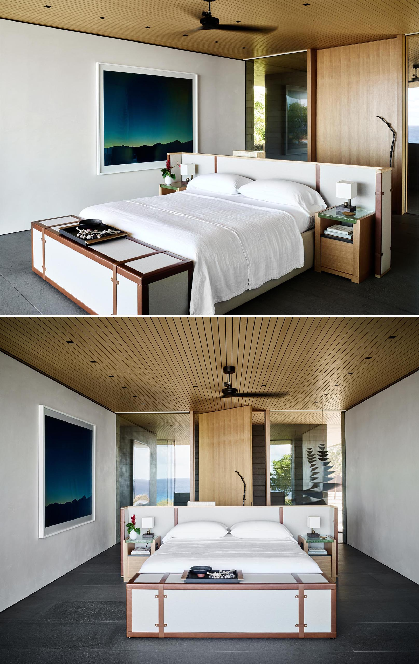 In this modern master bedroom, the bed frame has been centrally positioned in the room to take advantage of the views. There's also a hidden television at the end of the bed, and behind the headboard, there's a desk.