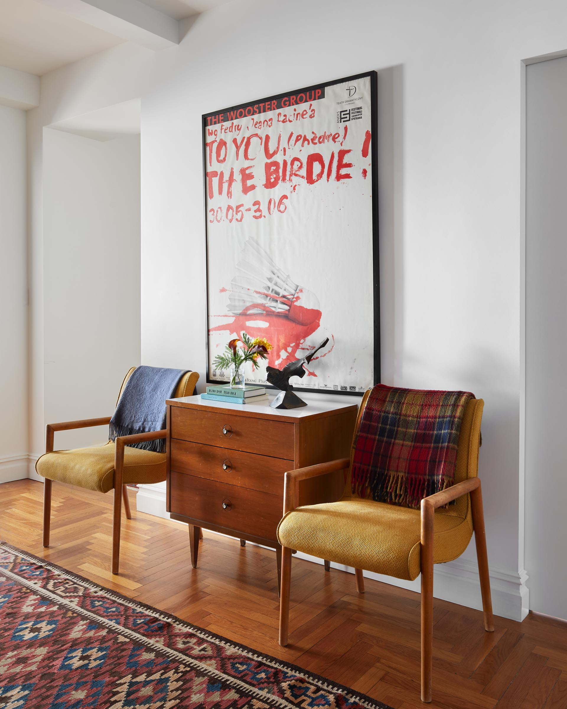 A remodeled entryway with mid-century modern furniture.