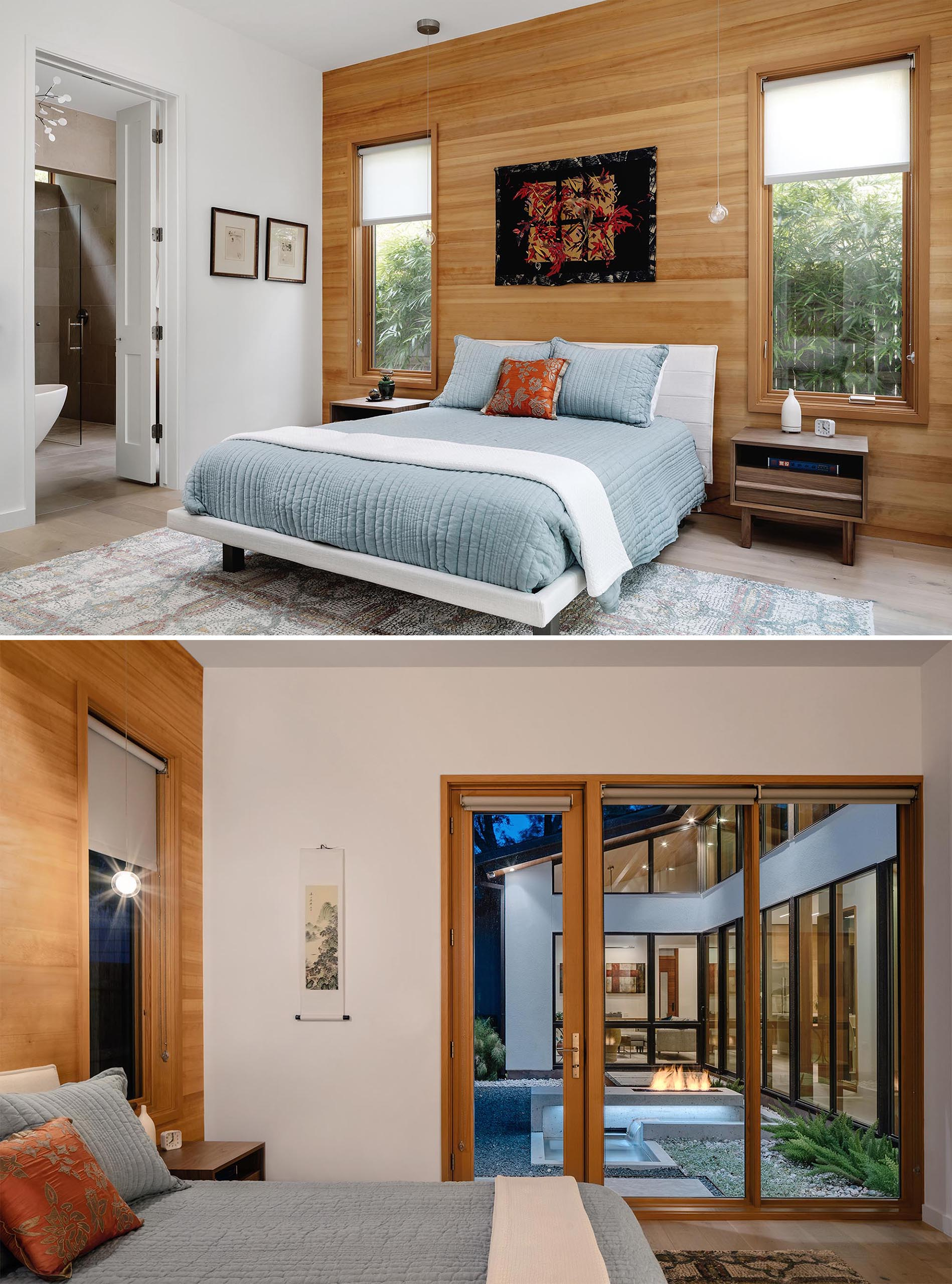 A modern bedroom with light blue bedding and a wood accent wall.
