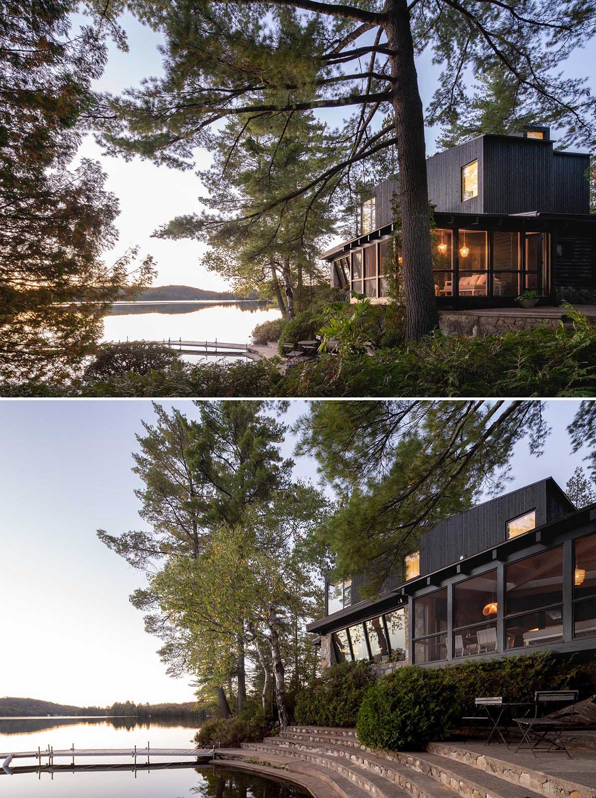 A log cabin with a stone foundation has a modern extension and screened-in porch.