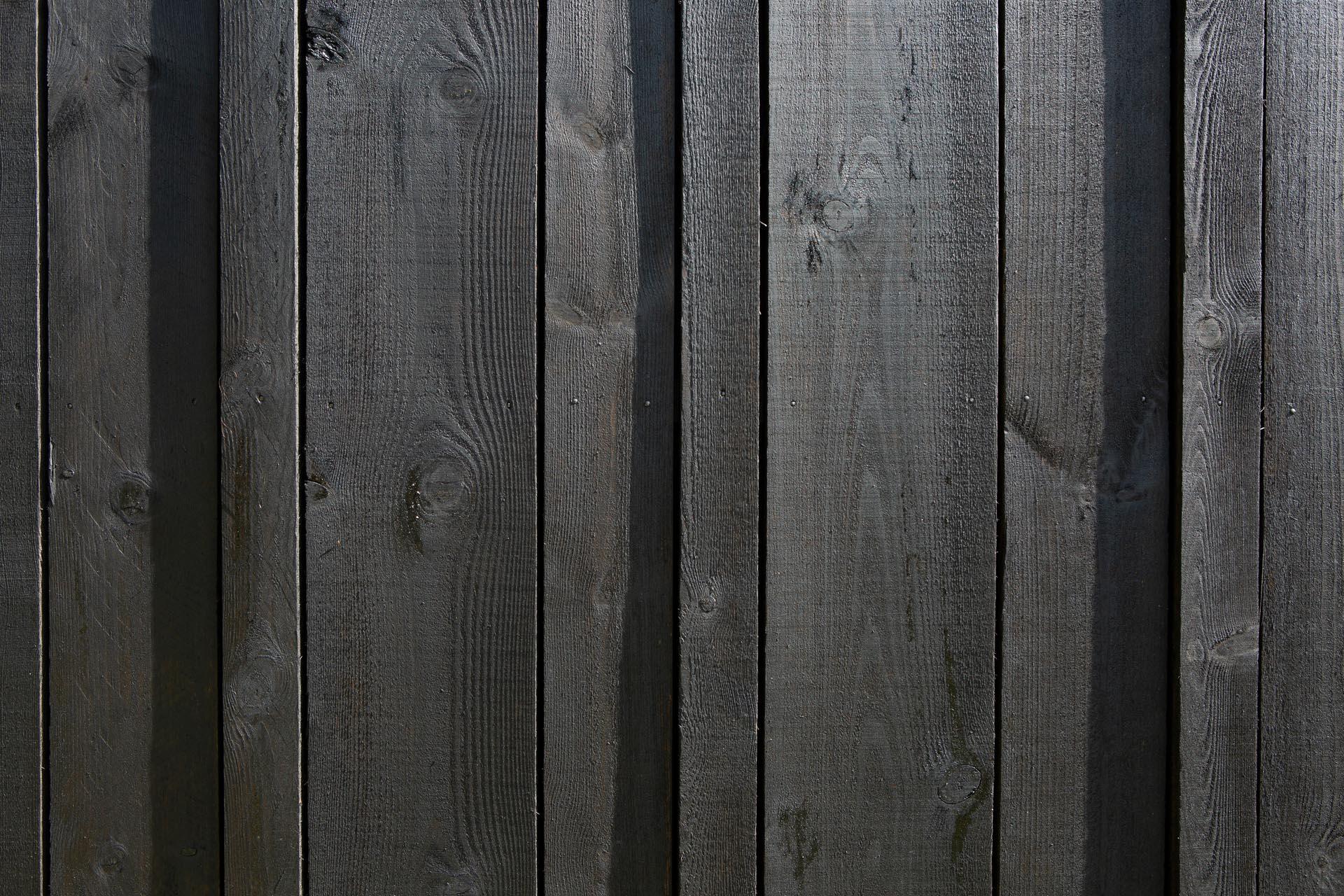 Matte black wood siding