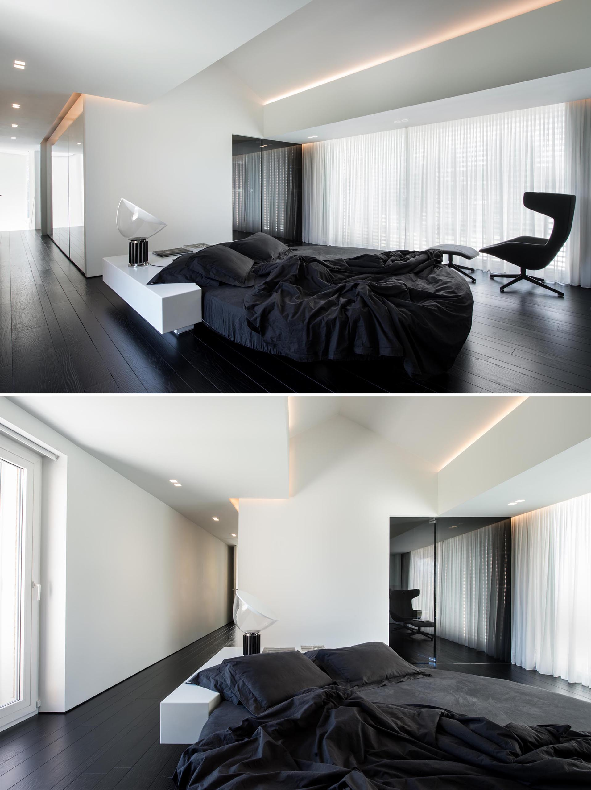 A modern bedroom with a black and white color palette, and a round bed.