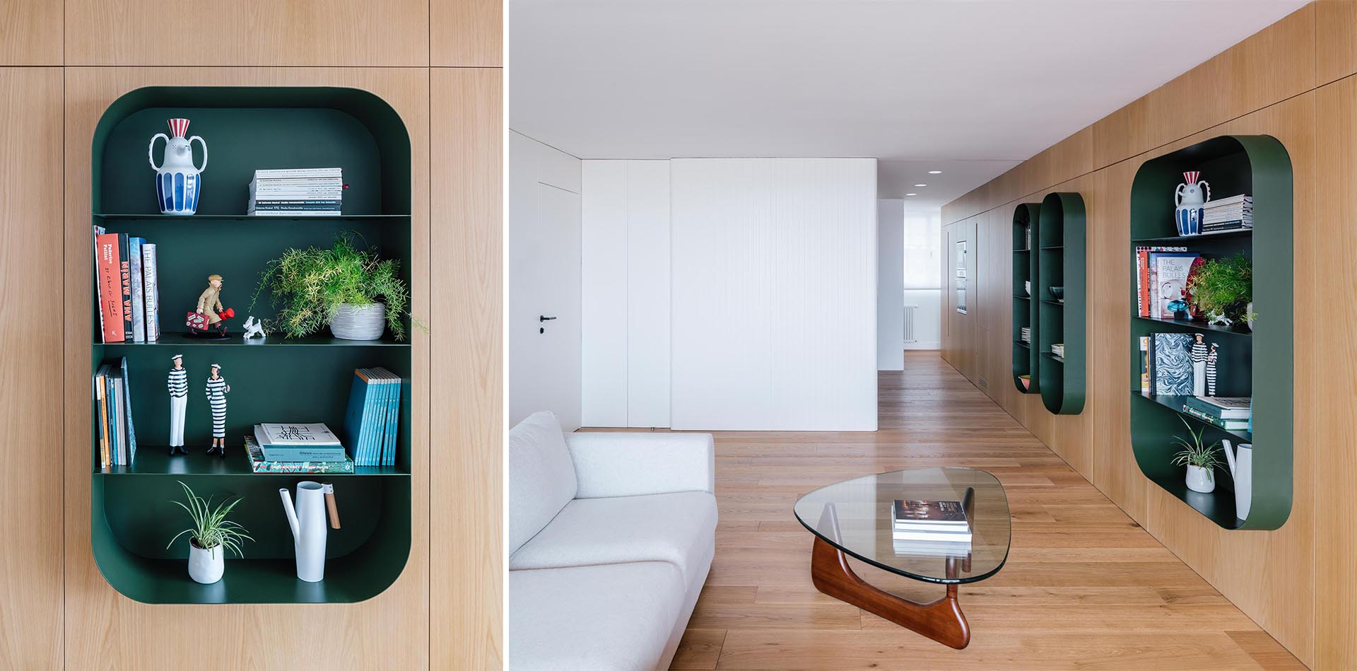 A modern apartment with dark green shelves embedded into the wall.