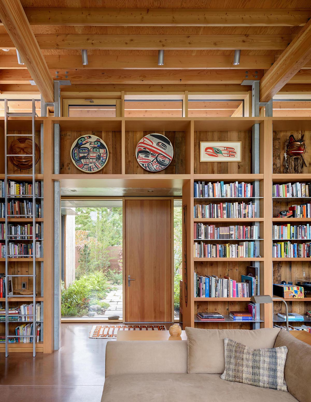 A modern cabin with wood shelving and 16ft high ceilings.