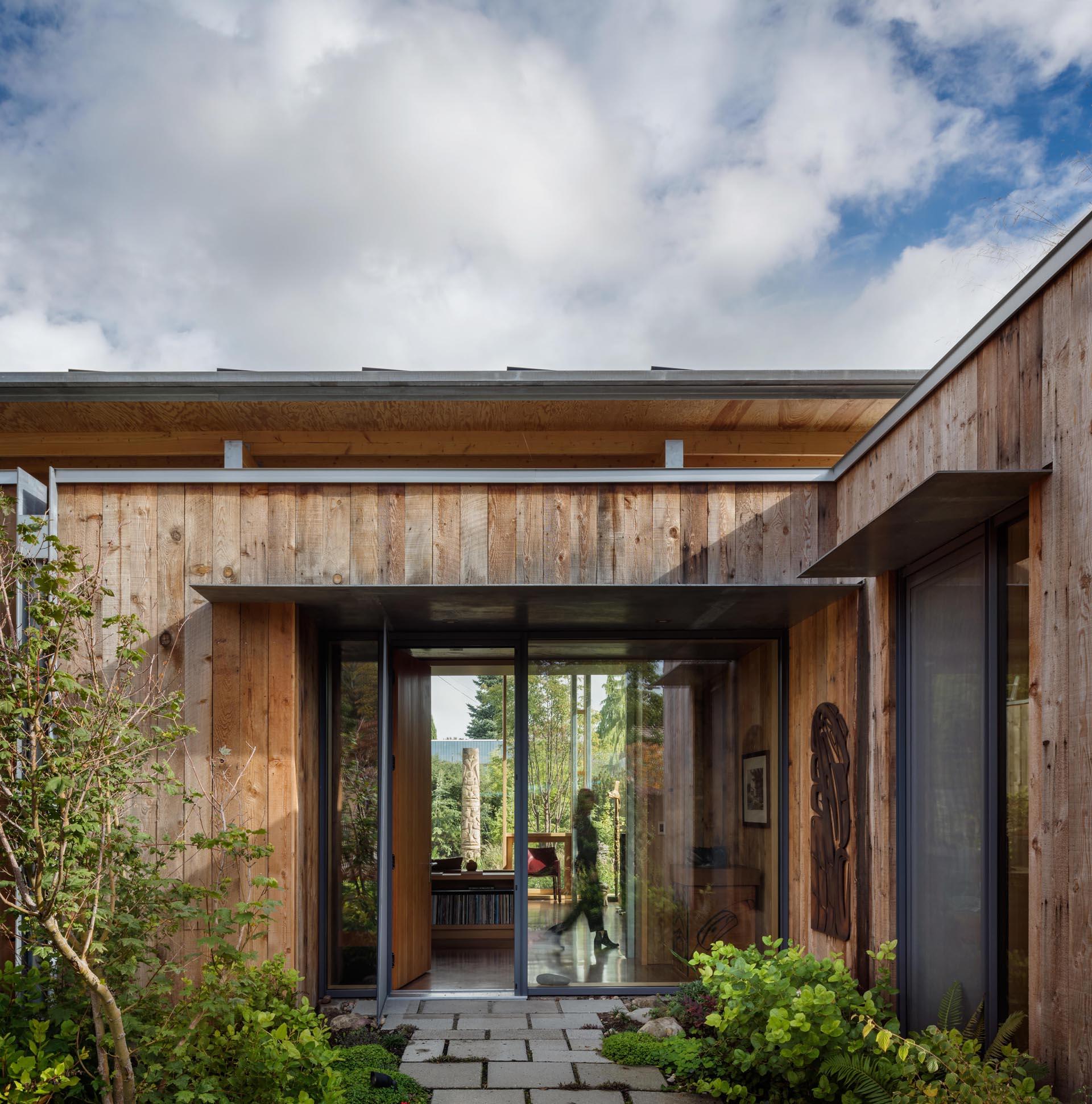 A modern cabin with fir wood exterior siding.