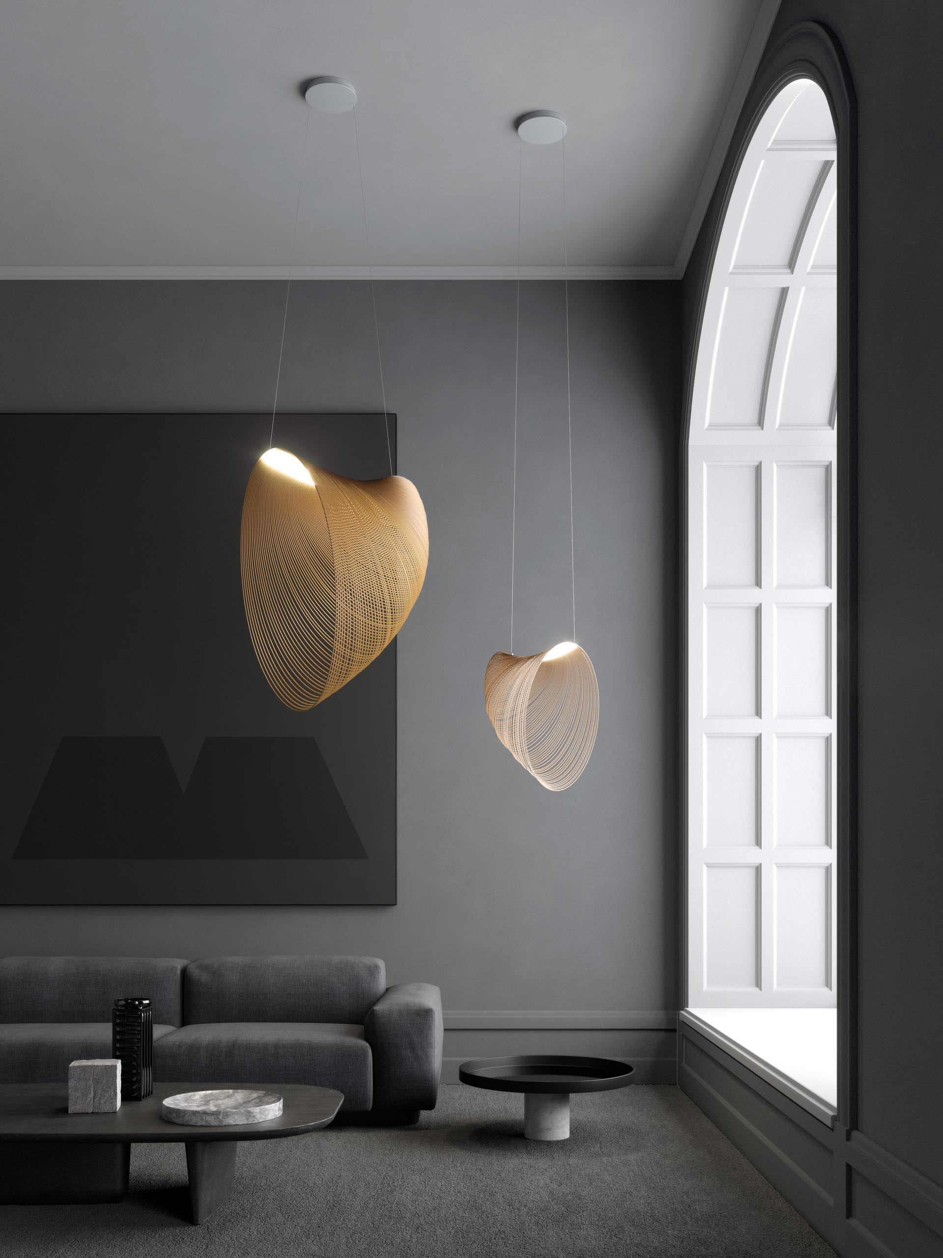 A pair of delicate pendant lights made from laser cut wood and LEDs.