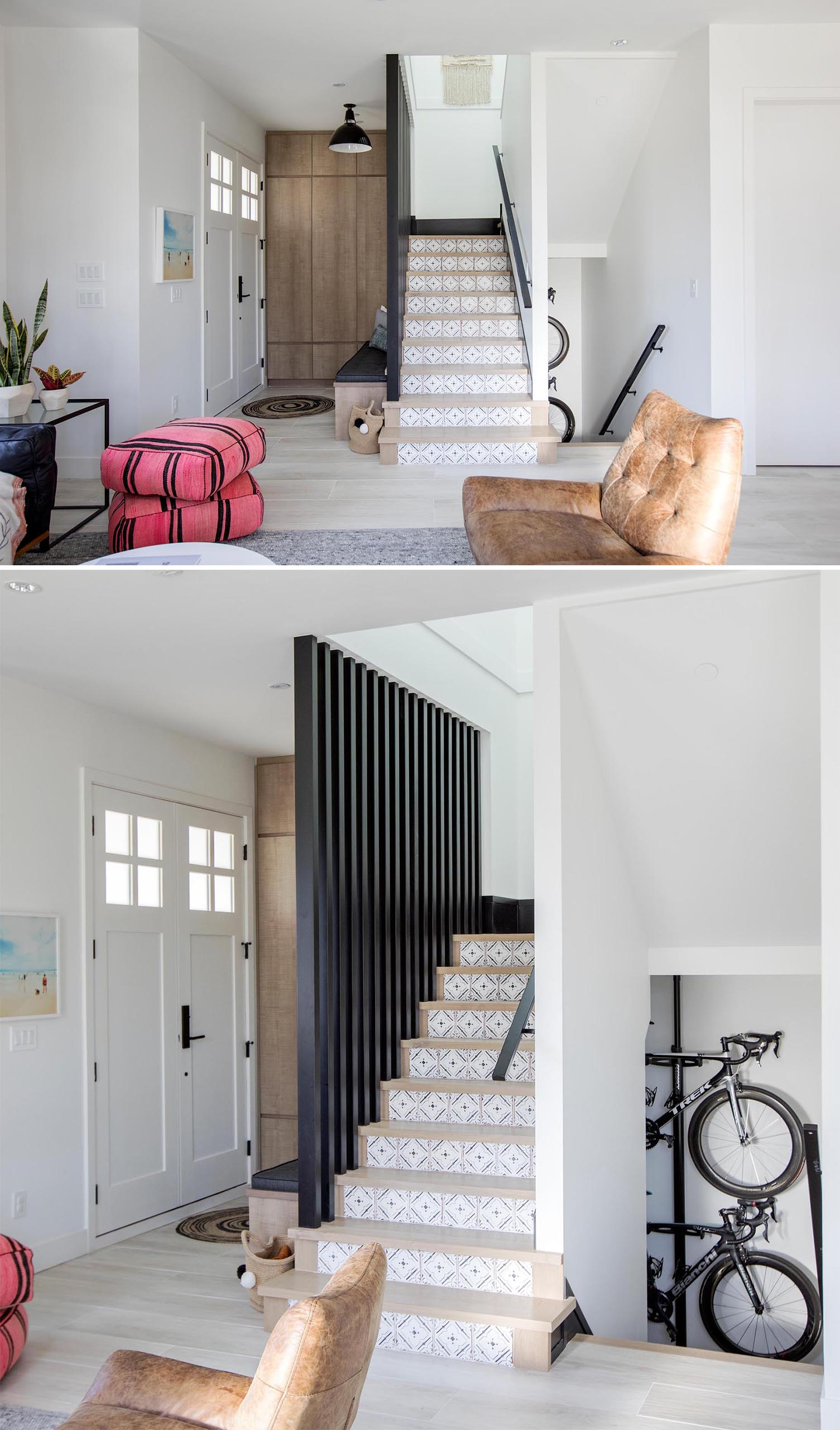 This modern home has a a small entryway furnished with a wood bench and a black upholstered cushion.