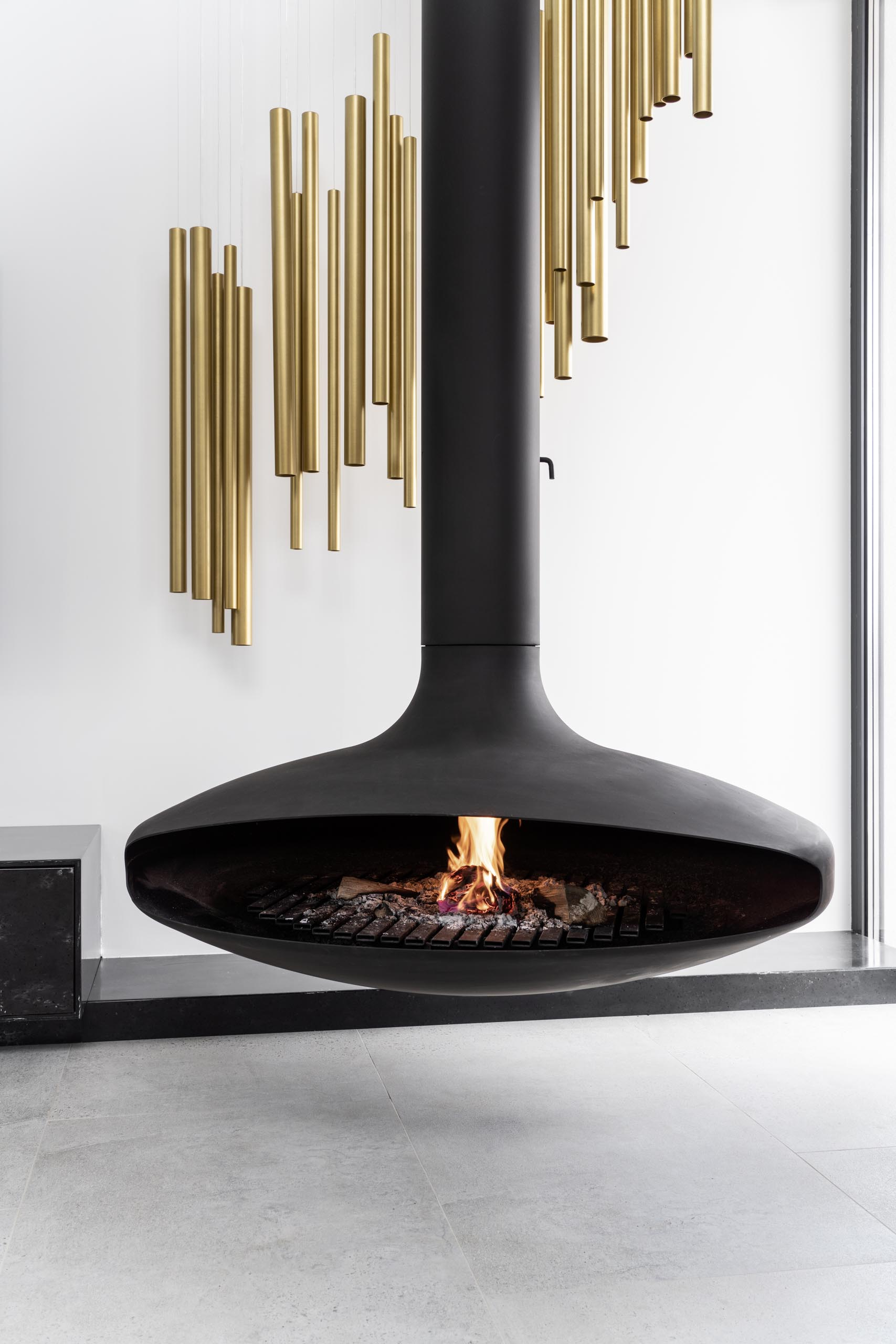 A suspended black fireplace.