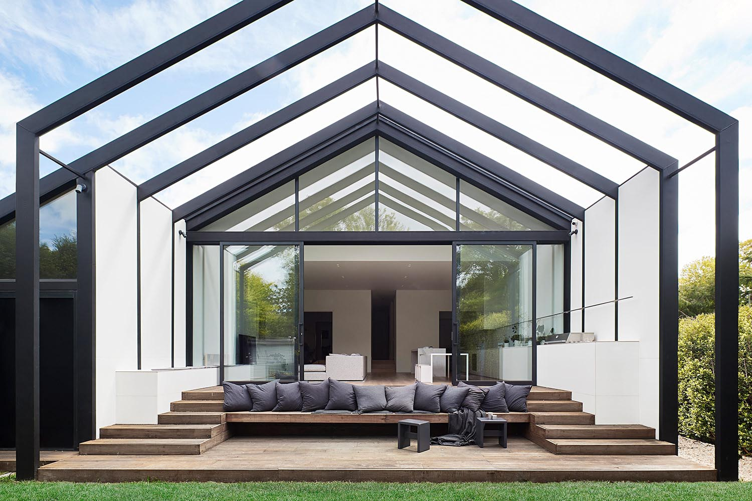 The two story addition has been designed as an indoor/outdoor transition zone, gently stepping down from the house interior to the outdoor seating area and the garden.
