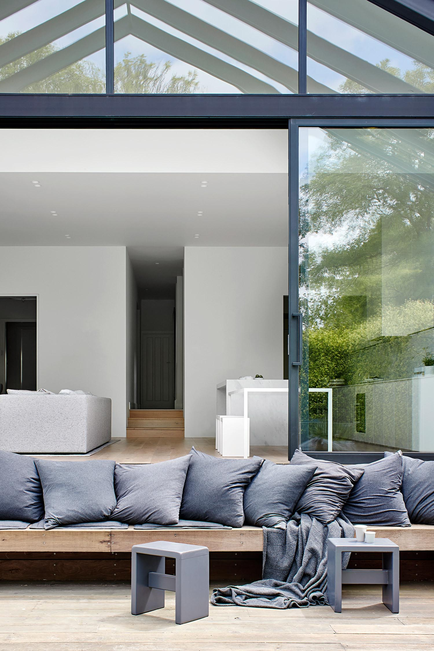 A modern house extension with a custom built outdoor seating area.