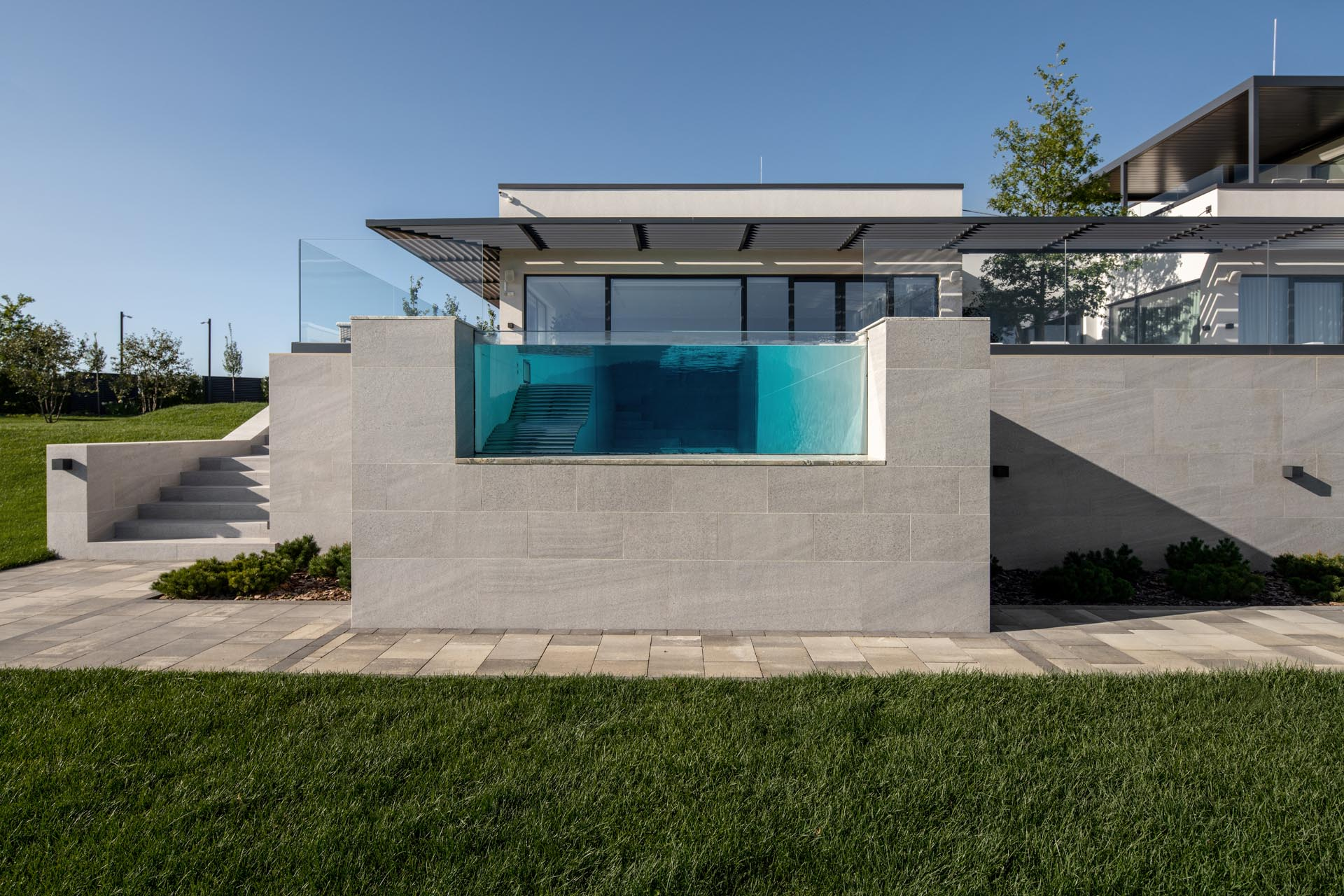 A 52ft (16m) long pool includes a window at one end, allowing the user to admire the landscape from within the pool.