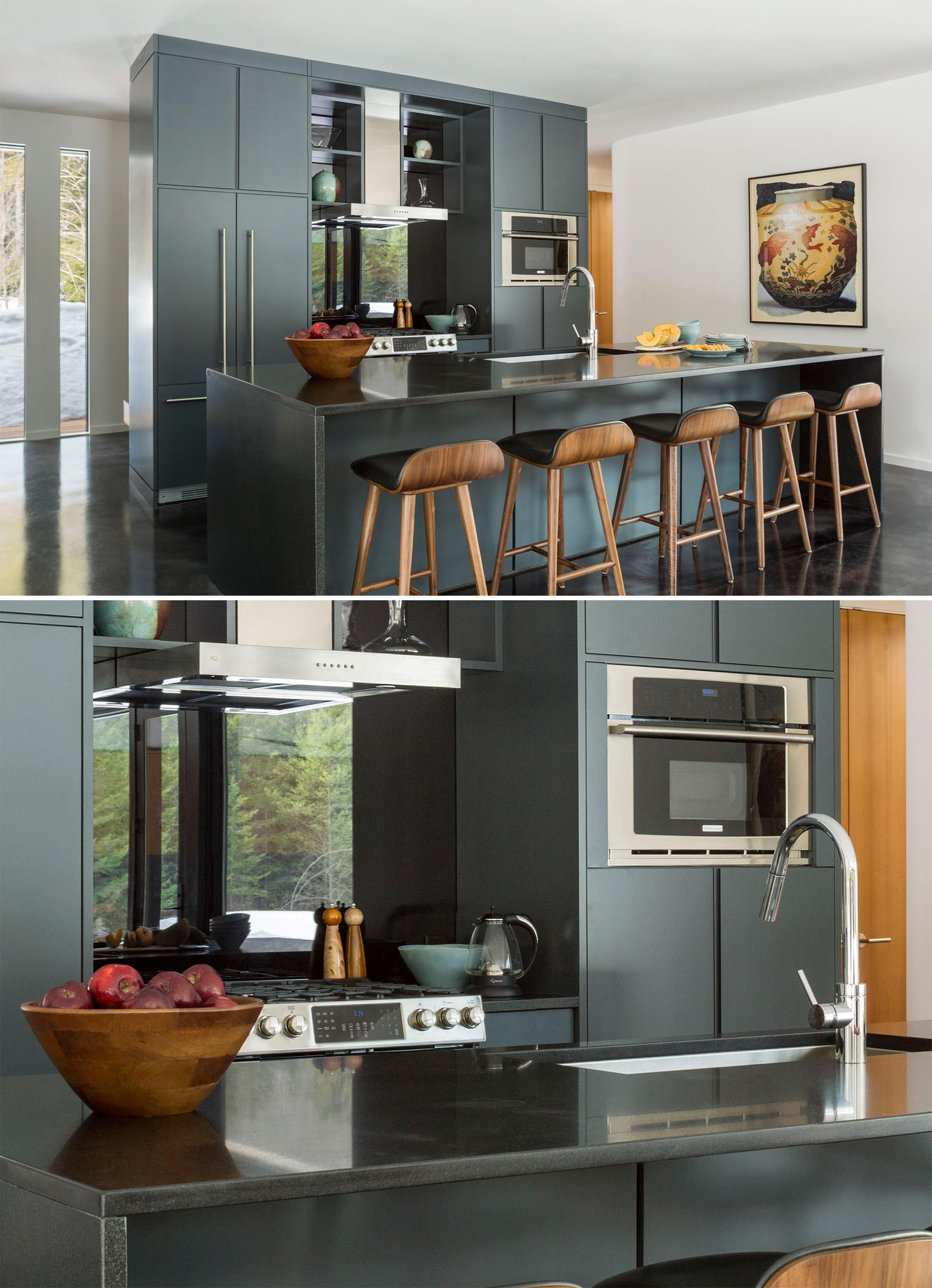 In this modern kitchen, dark gray cabinetry is paired with a dark countertop, while the stainless steel appliances and sink complement the cabinet hardware.