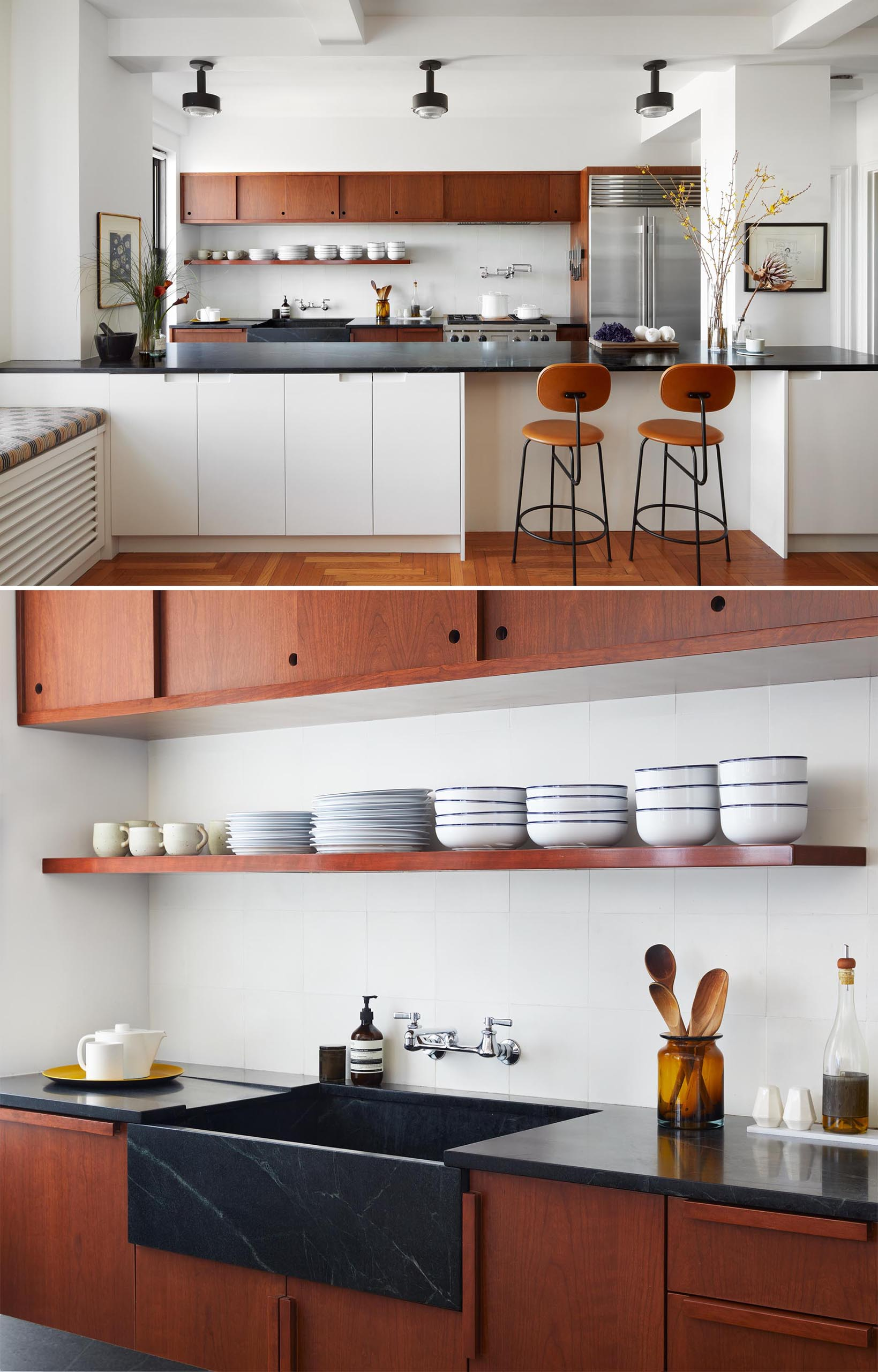 A remodeled kitchen with custom auburn cherry cabinetry inspired by mid-century Southern California woodwork, and has integrated handles and sliding doors, and a black soapstone countertop.