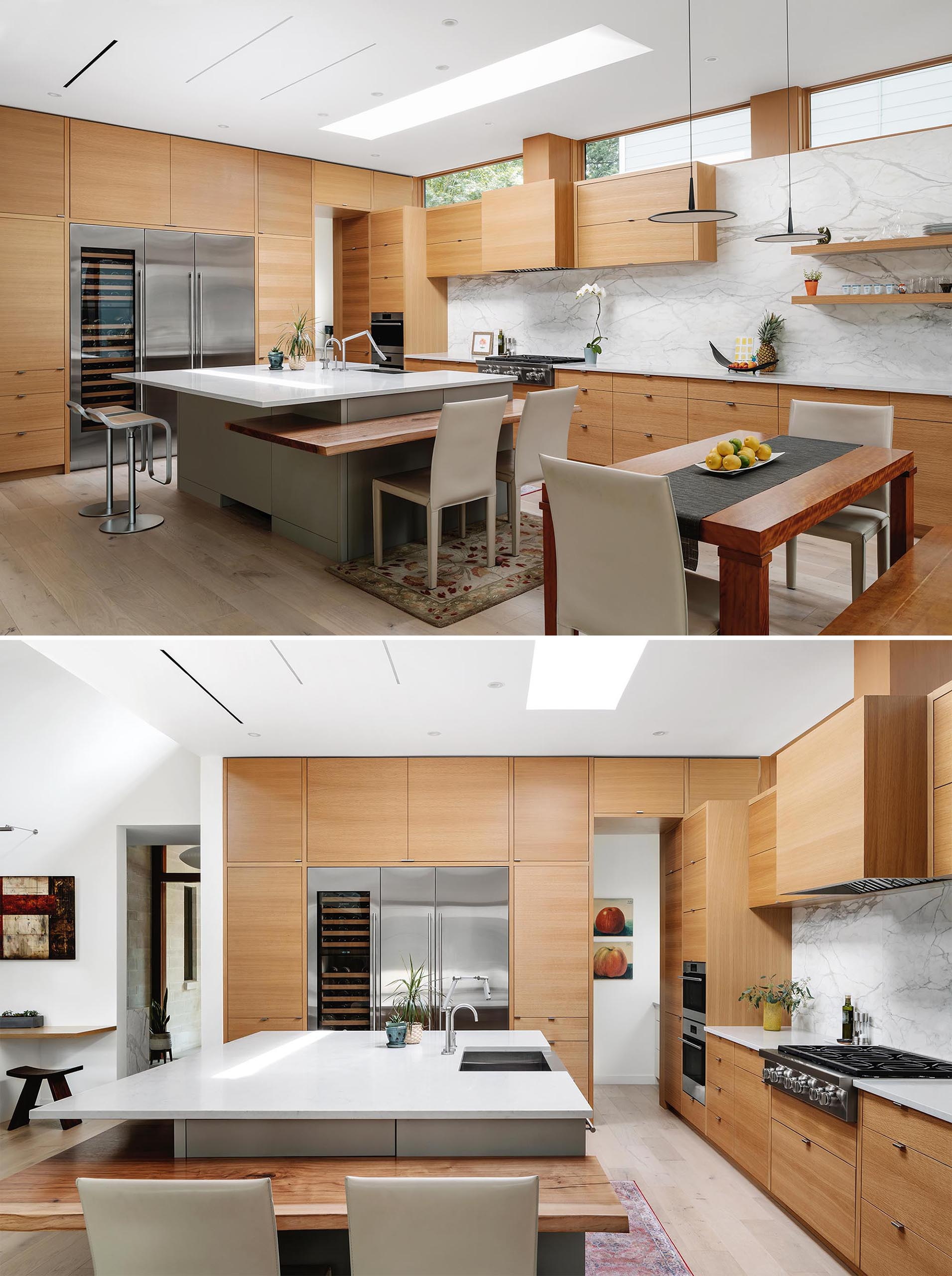 This modern kitchen has minimalist wood cabinets, a marble backsplash, and a large island with a couple of different seating options.