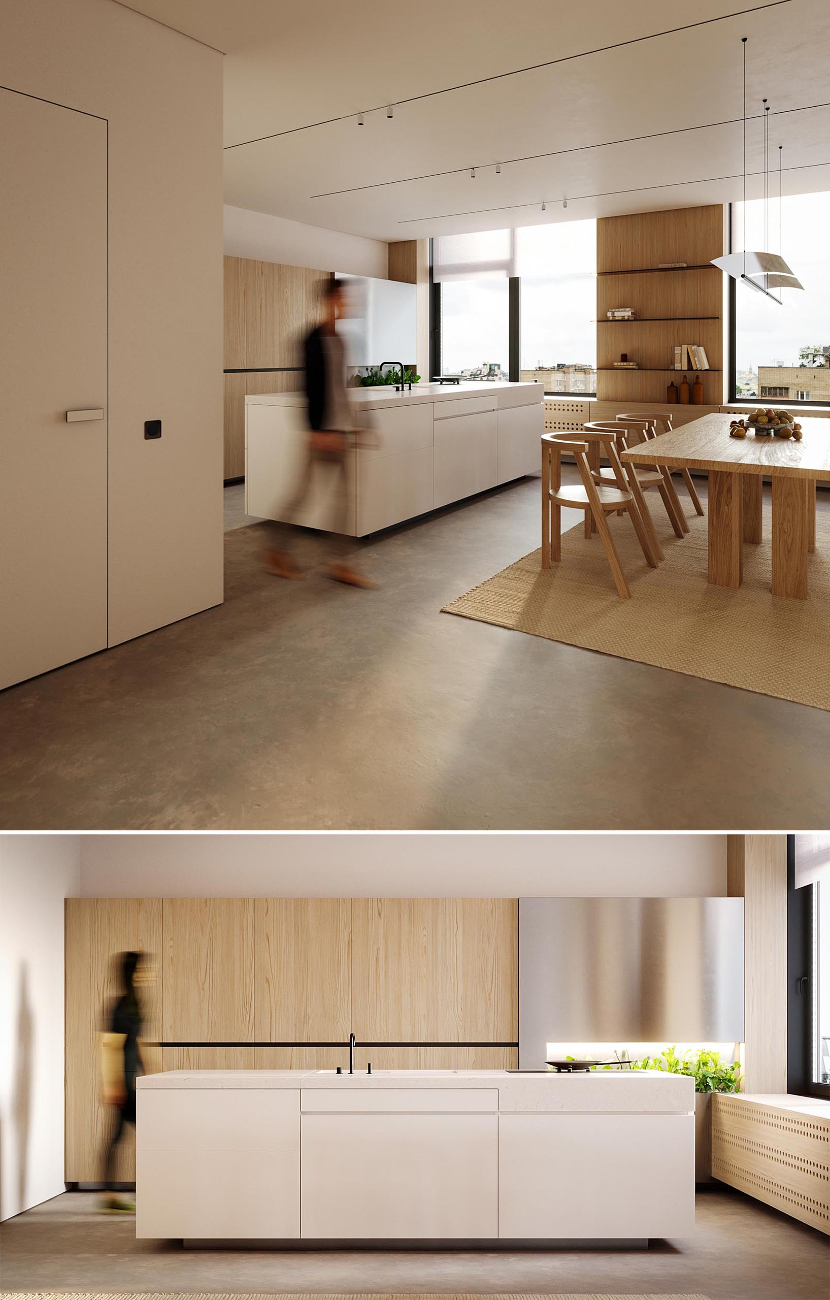 A modern kitchen with wood cabinets, a white island, and an area to grow herbs.