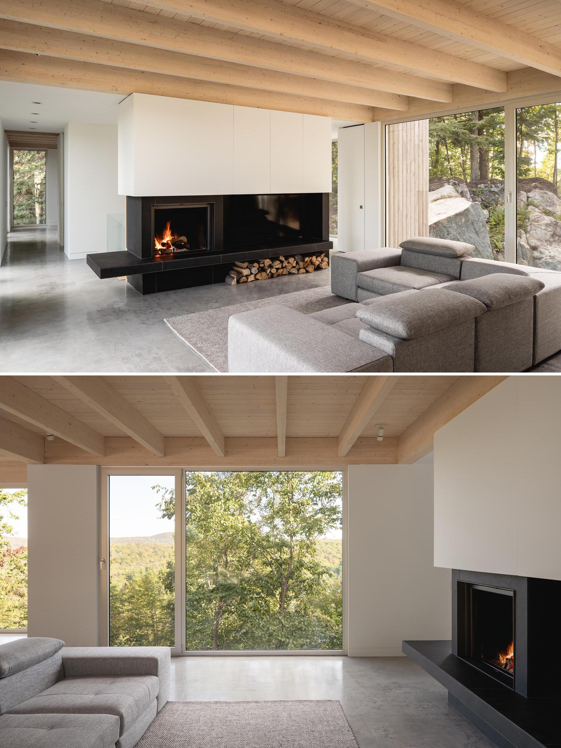 A black fireplace surround that incorporates the television adds a contrasting element, and the exposed roof structure is made from black spruce.