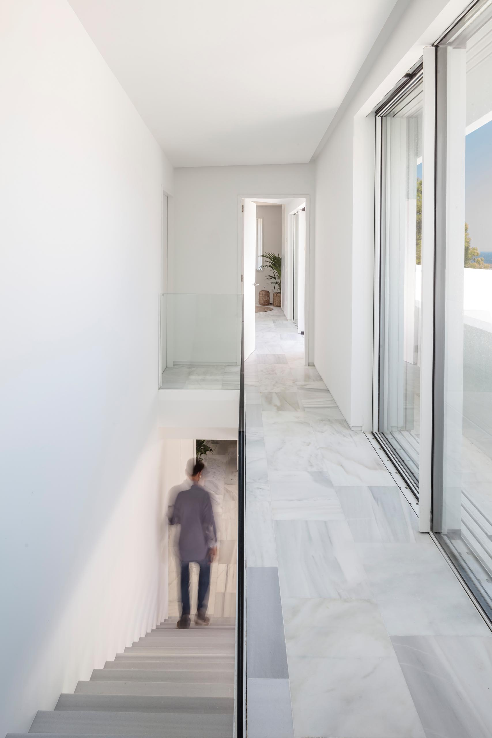 A modern house with an open hallway that overlooks the stairs.