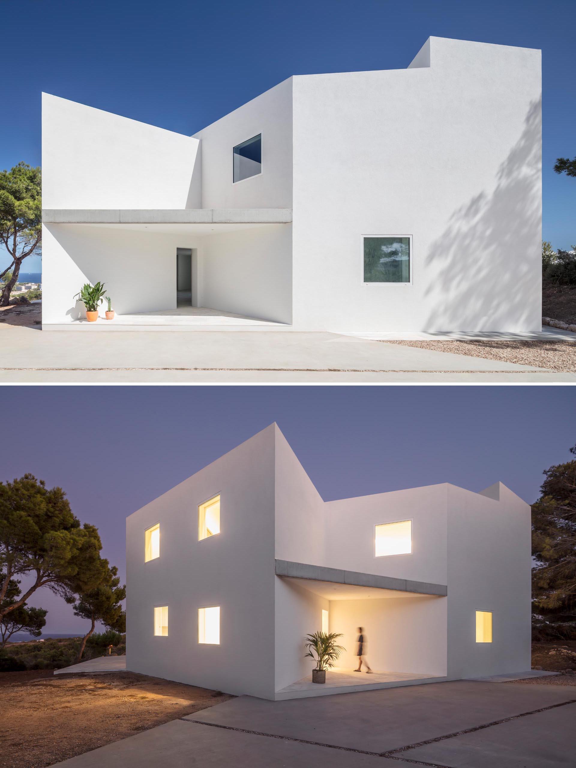 A modern white home with an angular design.