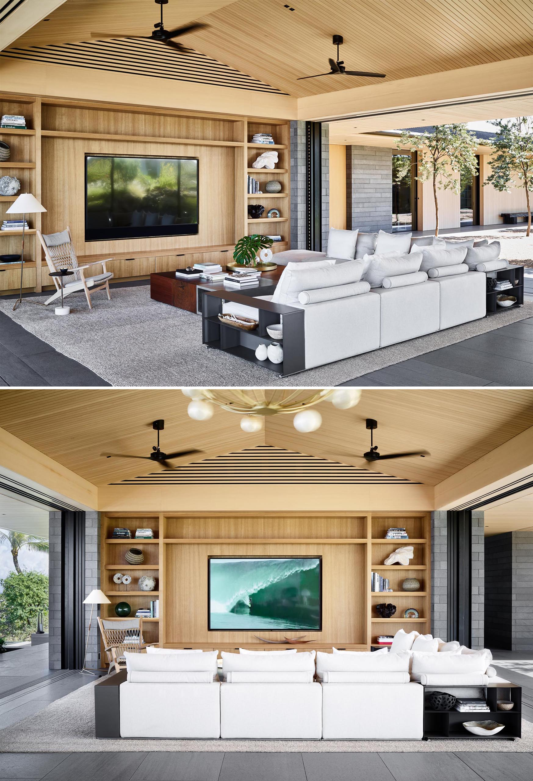 In this modern living room, a custom wood shelving unit takes up the entire wall, and light colored furniture like the sofa and accent chair, contrast the darker elements.