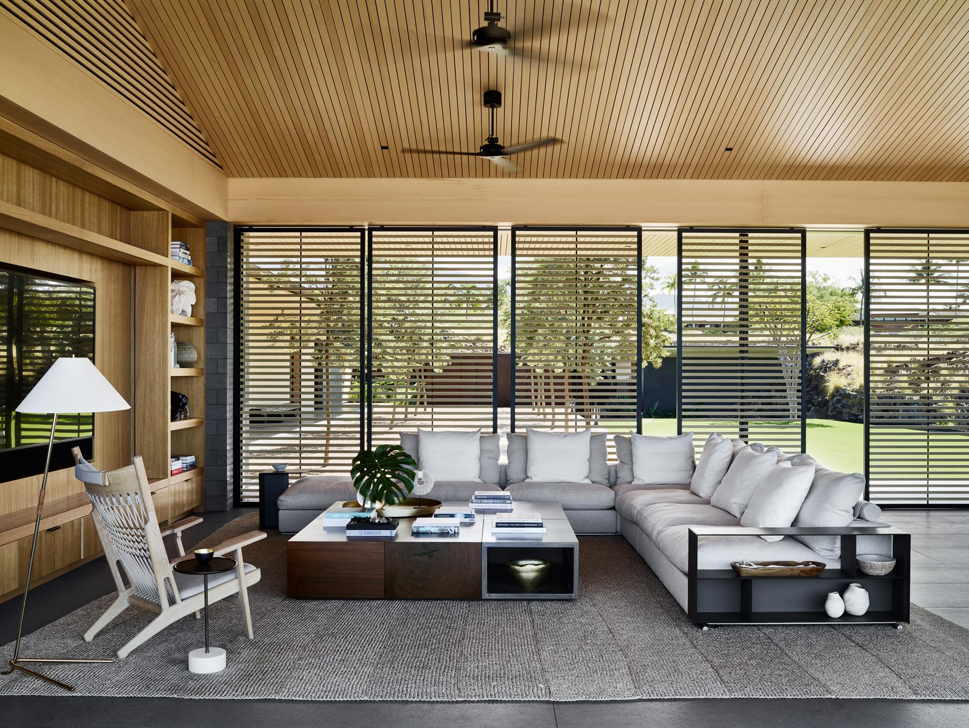 Screens provide shade from the sun in the living room.