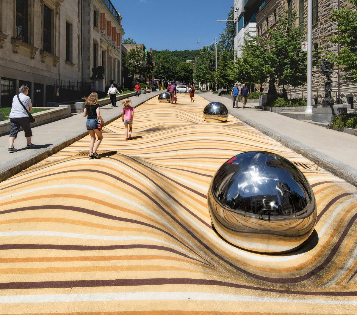 A public mural in Montreal that manipulates the street surface and creates the illusion of large ripples.