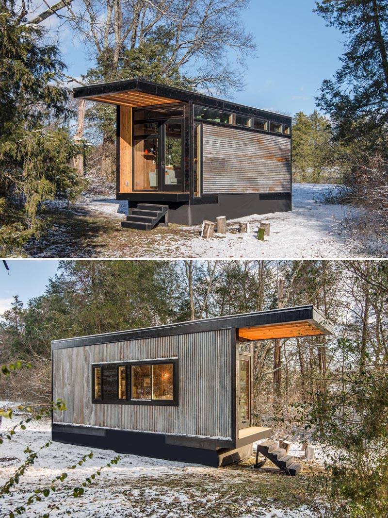 Measuring in at just 256 square feet (23sqm), this tiny house exterior showcases weathered, reclaimed corrugated tin, that's vertical on one side, horizontal on the other.