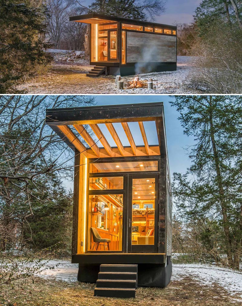 This modern tiny house has corrugated metal siding, shou sugi ban cedar trim, and a cantilevered deck and pergola.