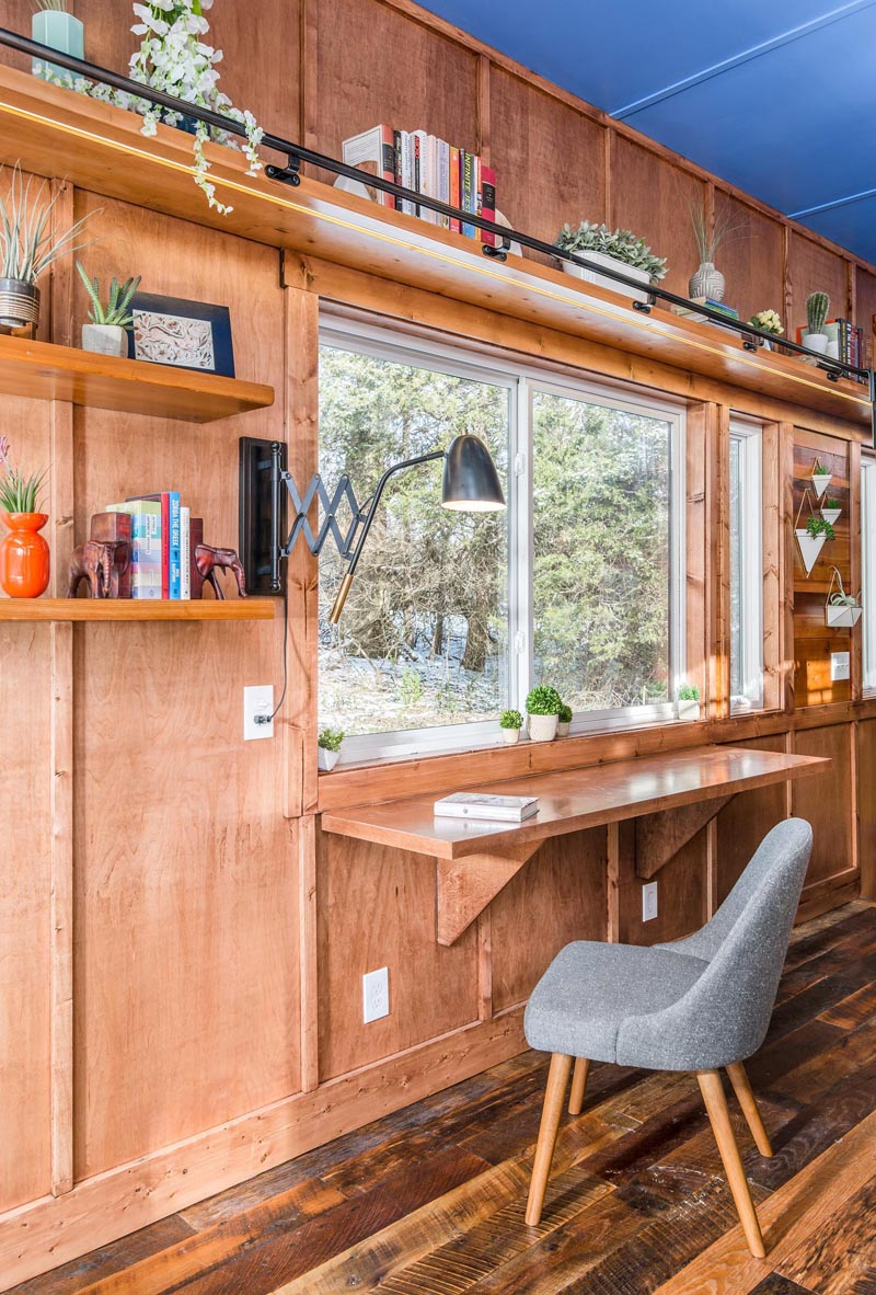 This tiny home has a solid maple fold out desk that takes advantage of the natural light coming in through the window.