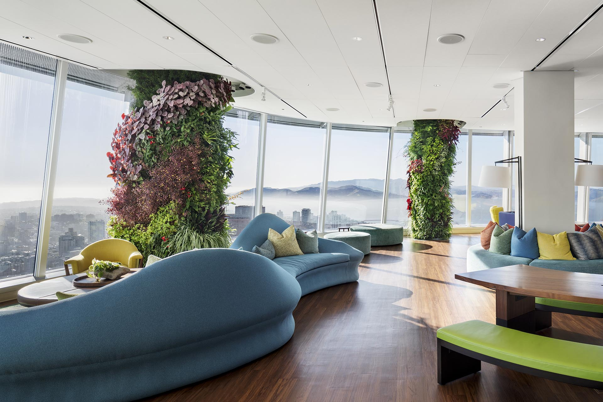 24 columns that surround a circular office floor have been remodeled to create eye-catching vertical gardens.
