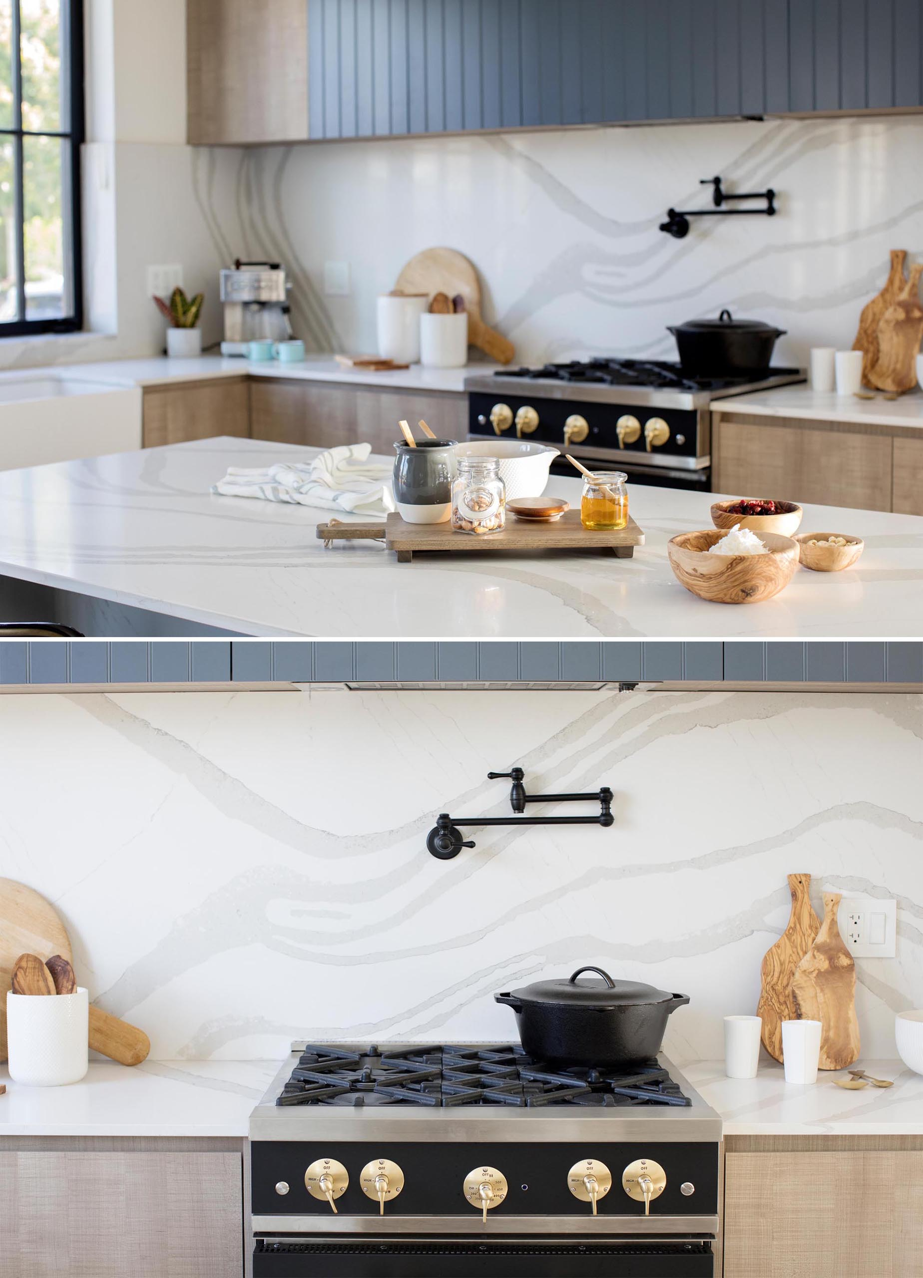 A modern kitchen with marbled backsplash and matching countertops.