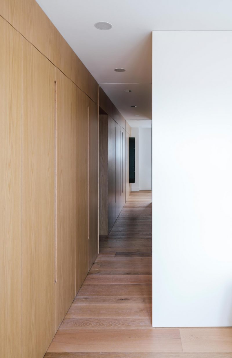 A wood wall with built-in closets.
