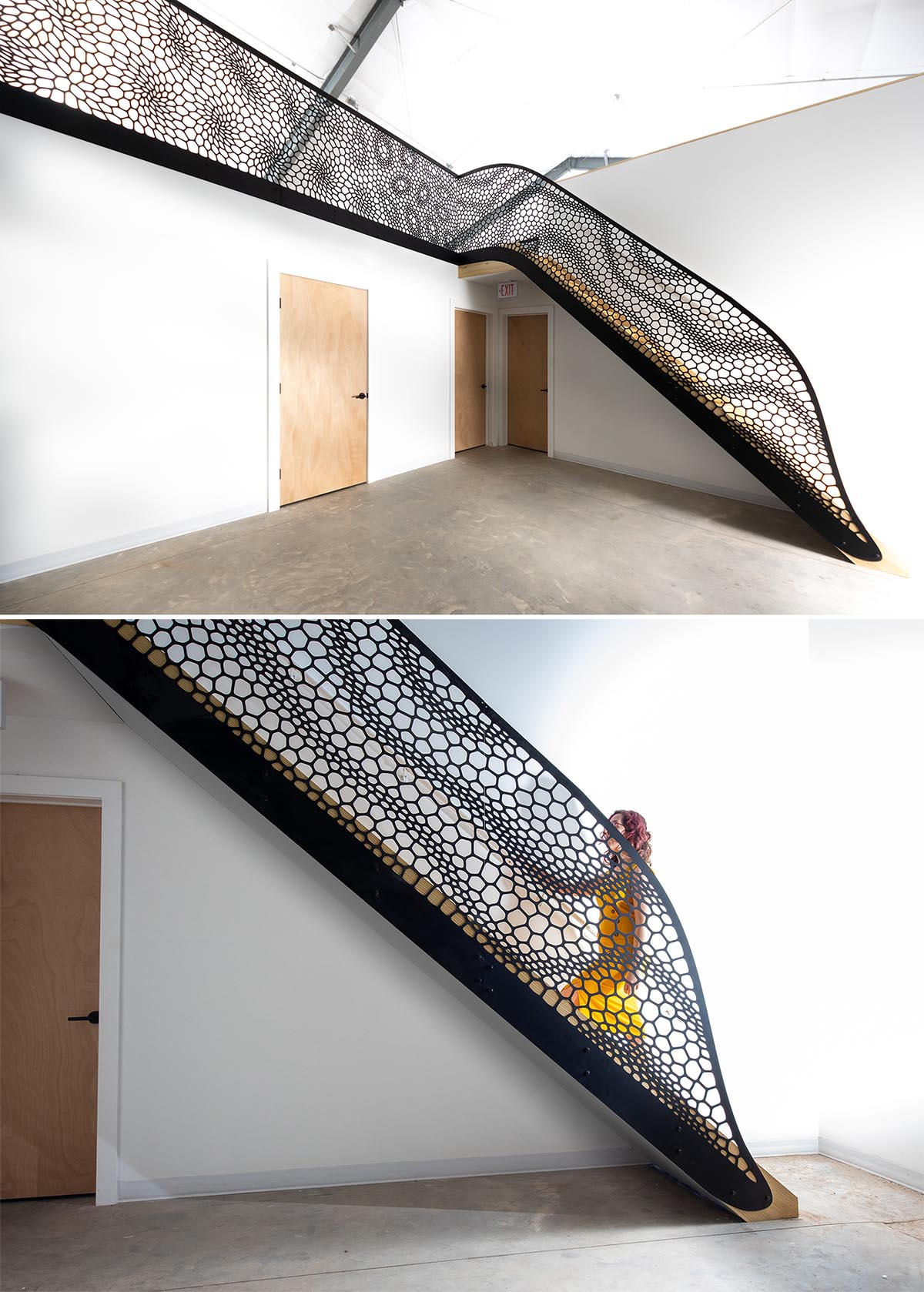 An artistic laser cut staircase railing with a matte black finish.