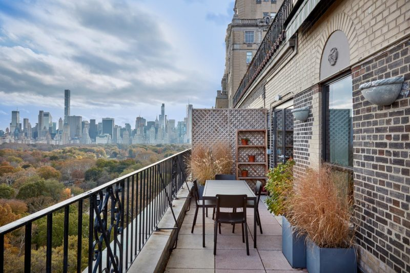 An apartment balcony with views of Central Park.