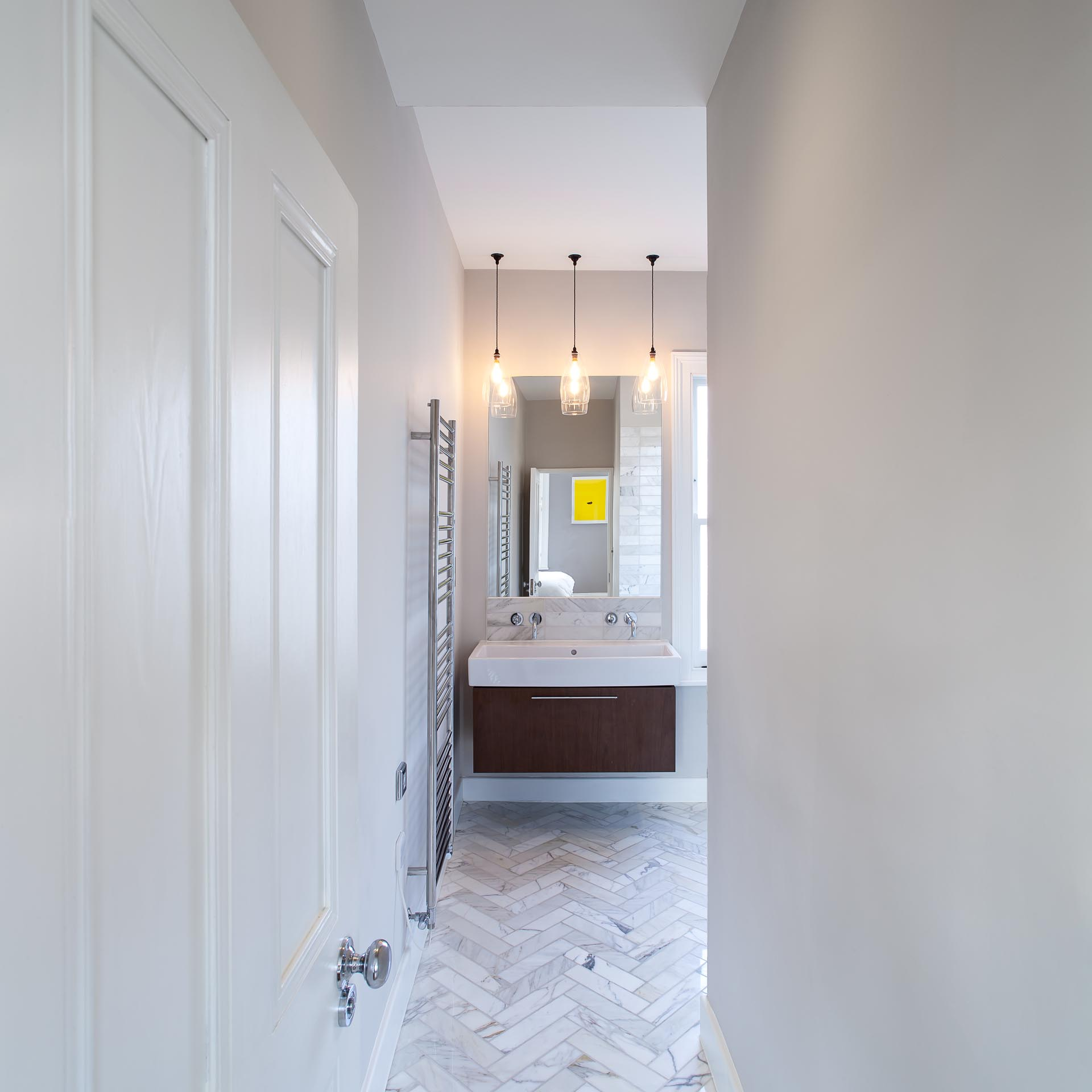 In this contemporary bathroom, gray stone tiles have been used on the floor and walls.