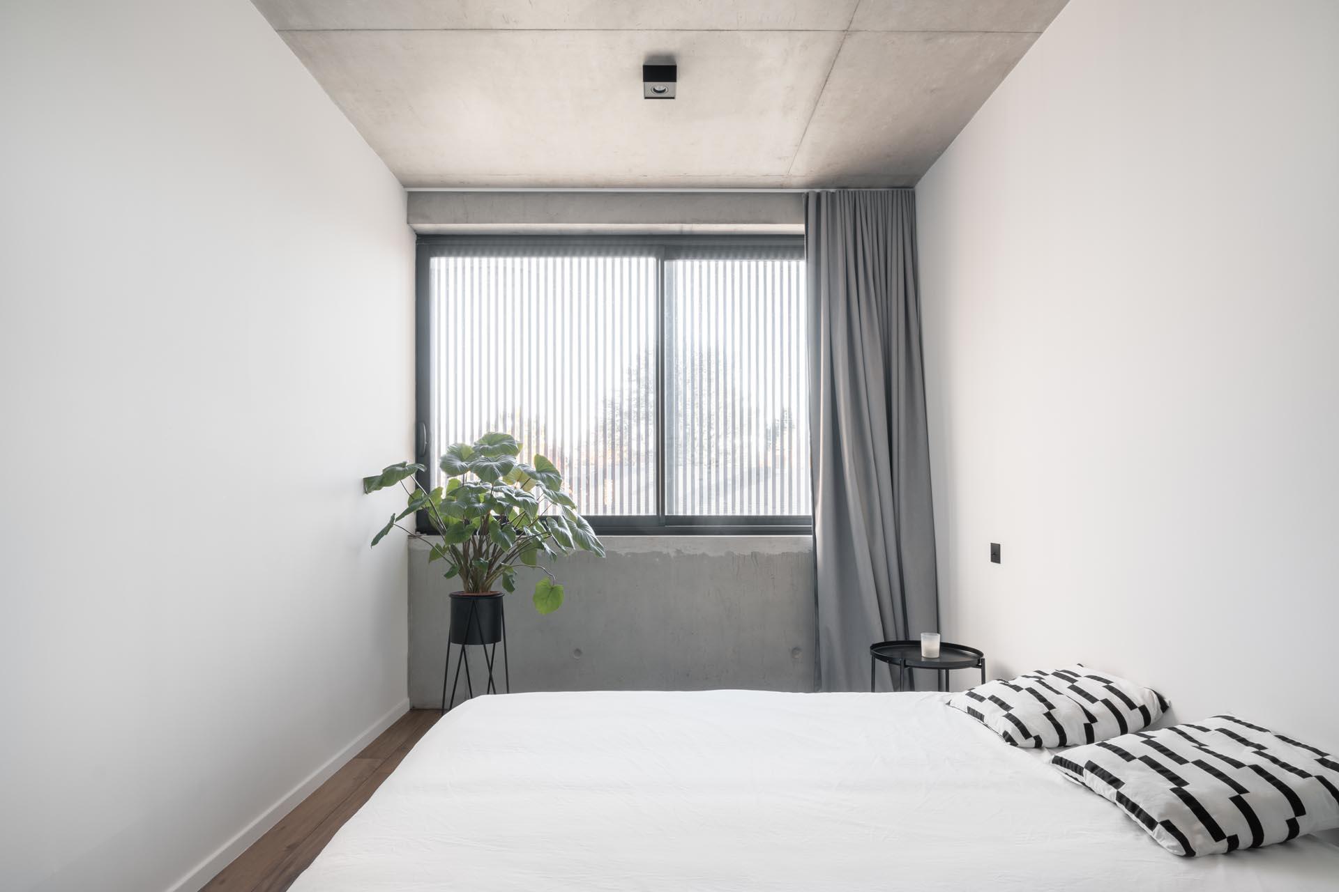 A modern bedroom with minimalist furnishings.