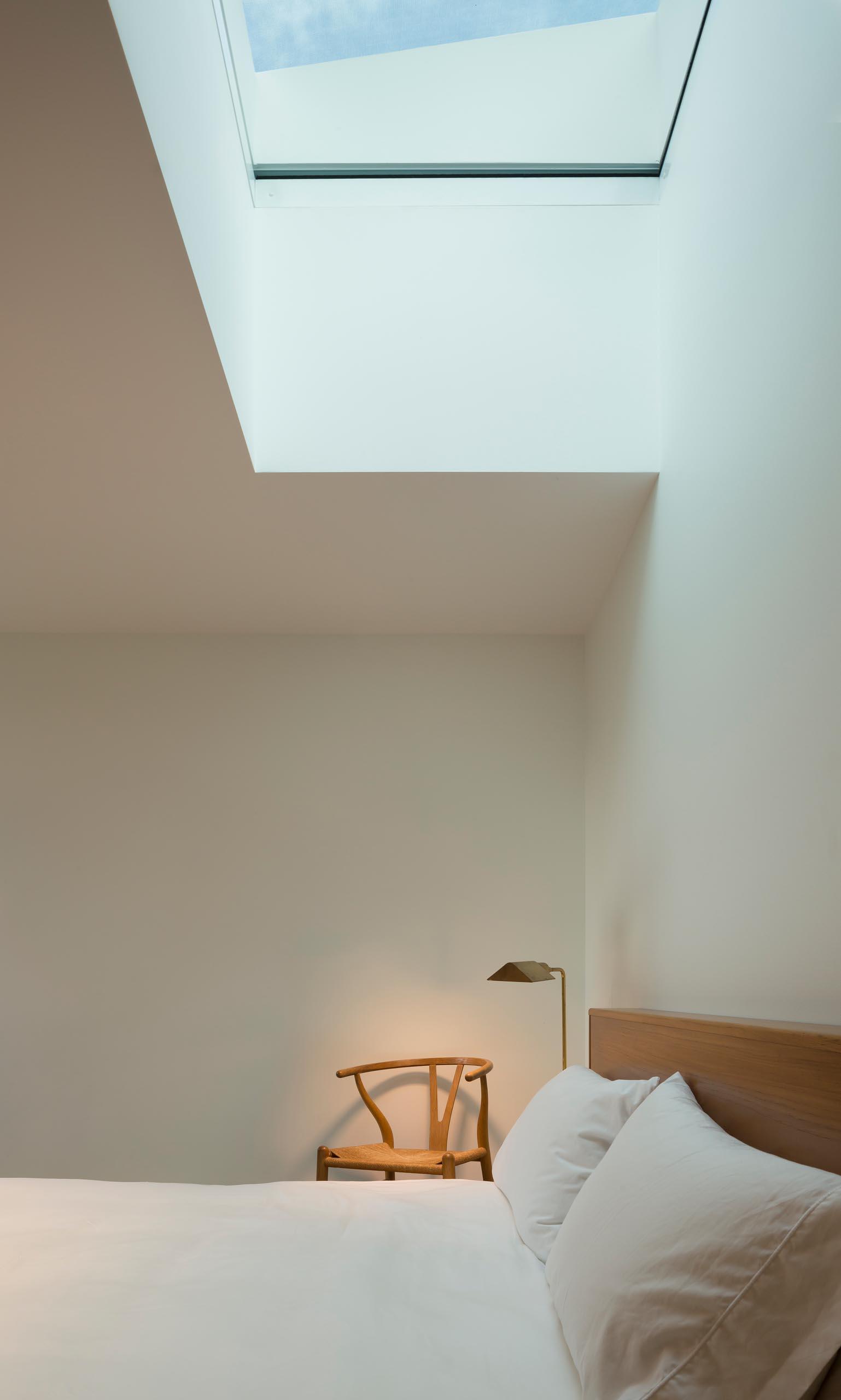 A modern bedroom with a skylight.