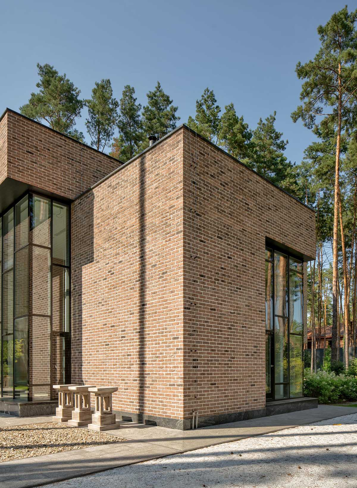 A modern brick home with black window frames.