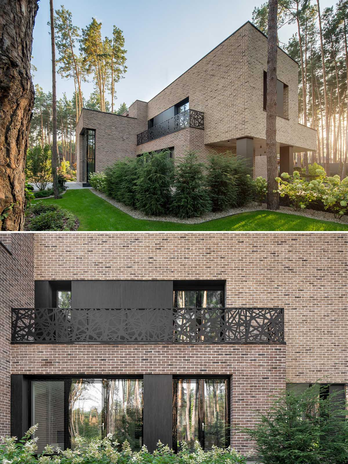 Complementing and contrasting the brown brick of this home are the black steel window frames, panels, and balcony railing.