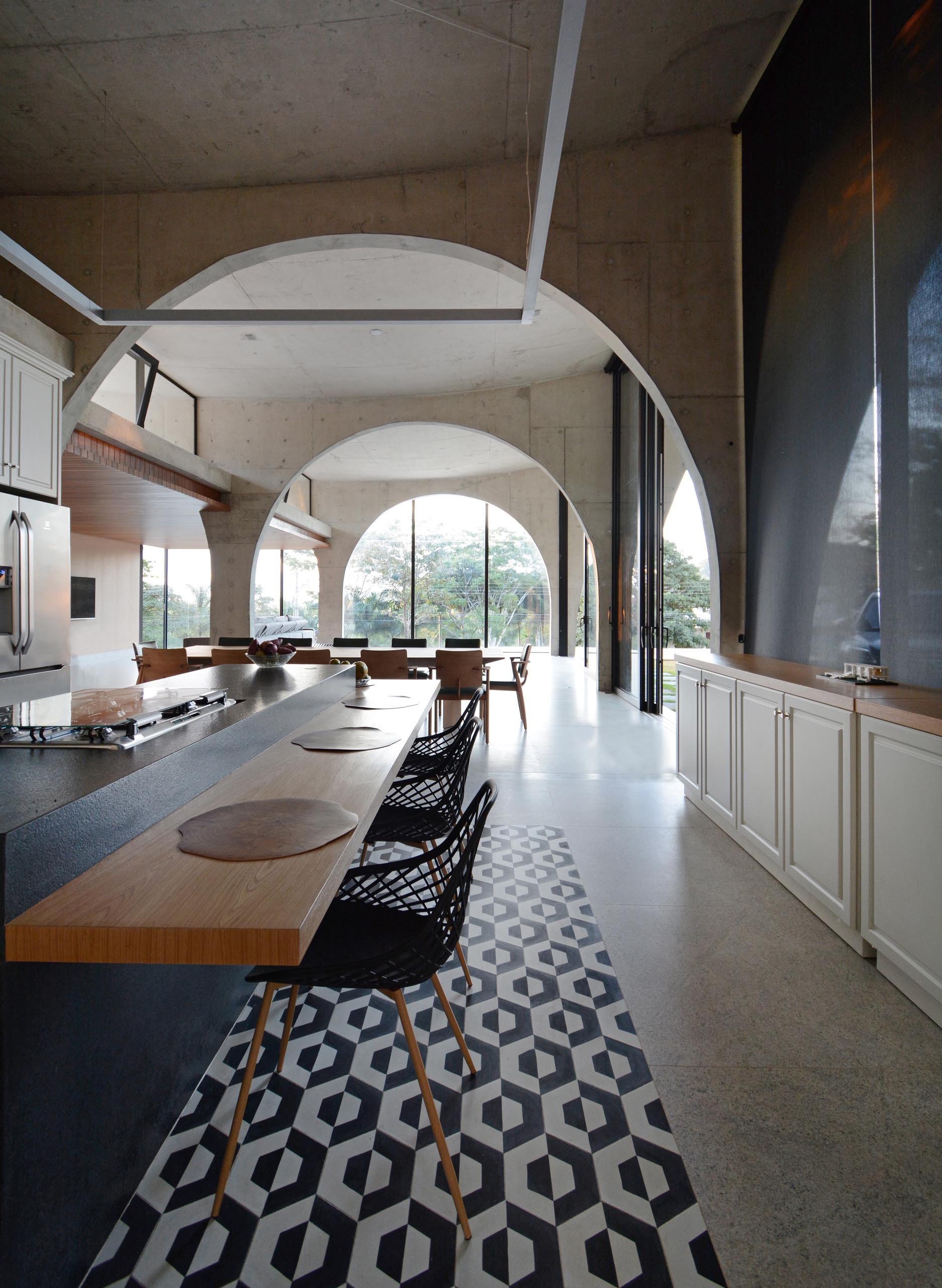 A modern home with large concrete arches that allow for an open floor plan.