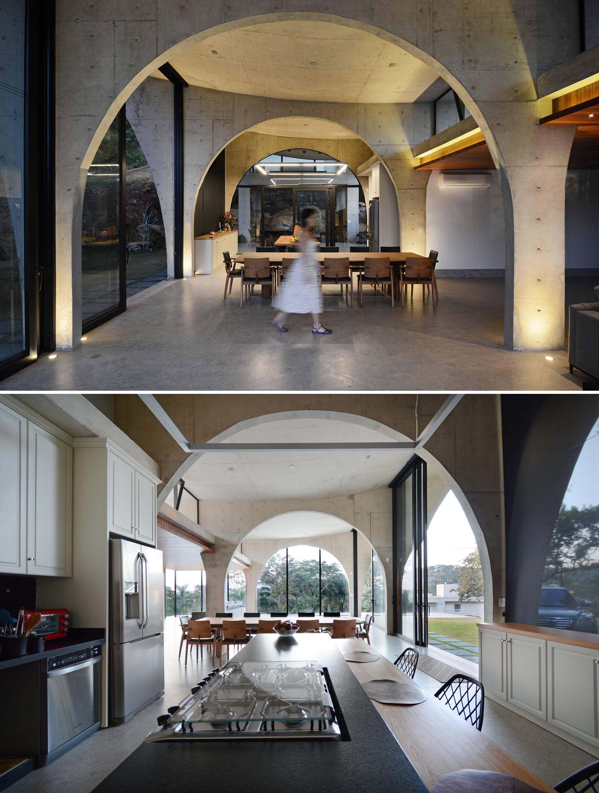 Concrete arches are key in creating an sense of space and height throughout this modern home.