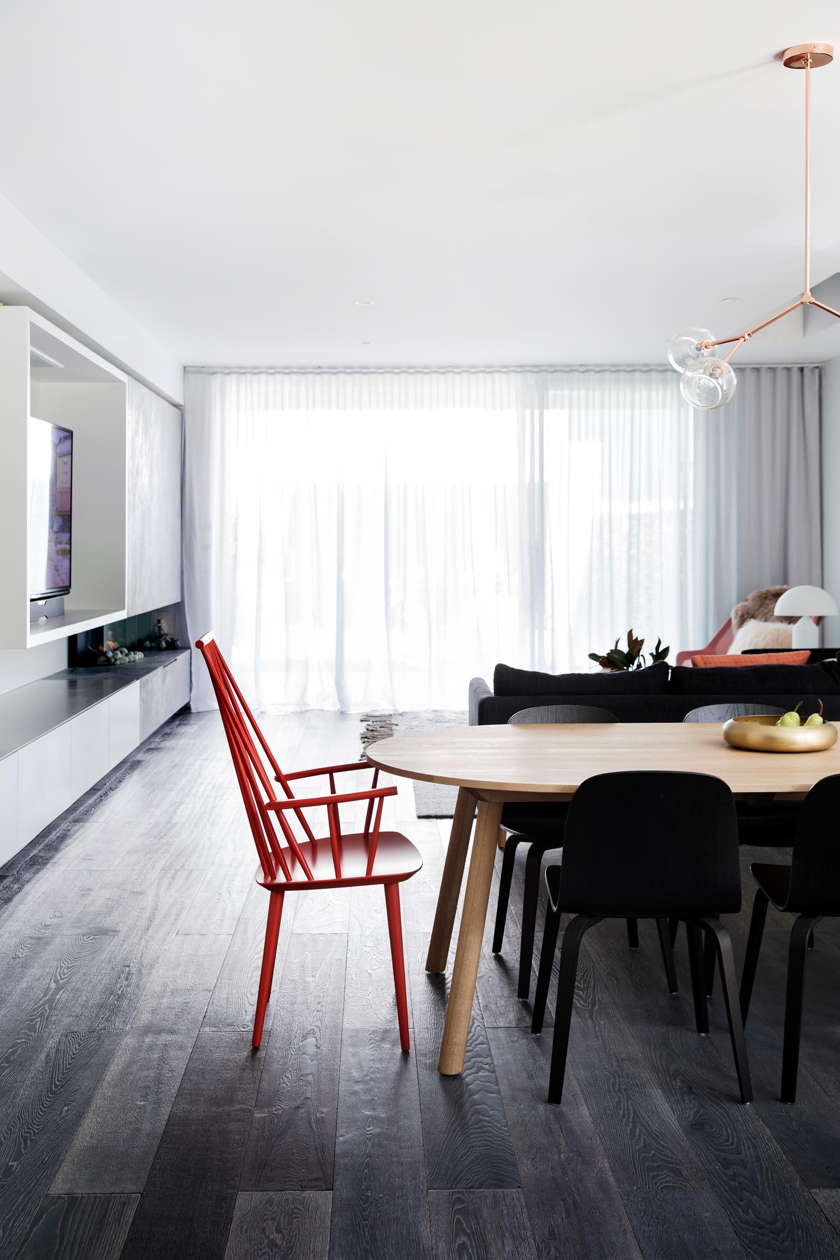 An open plan dining room with dark wood floor.