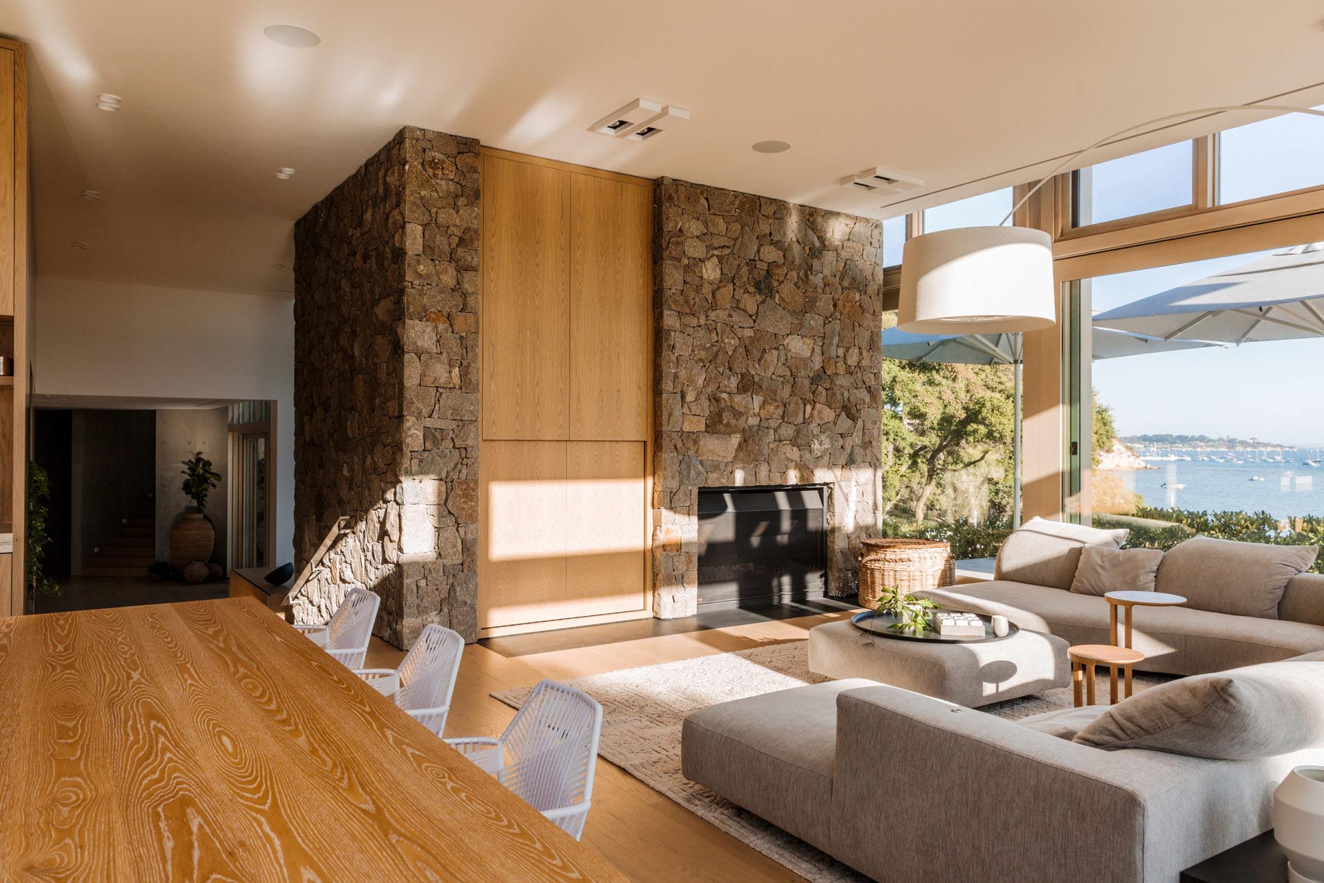 A modern home interior with a stone wall accent.